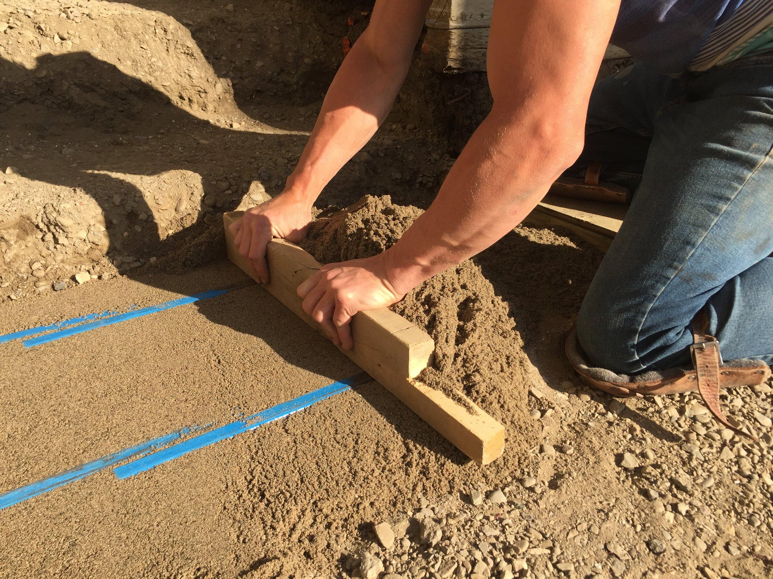 Screeding bars make for easy leveling of your bedding sand.