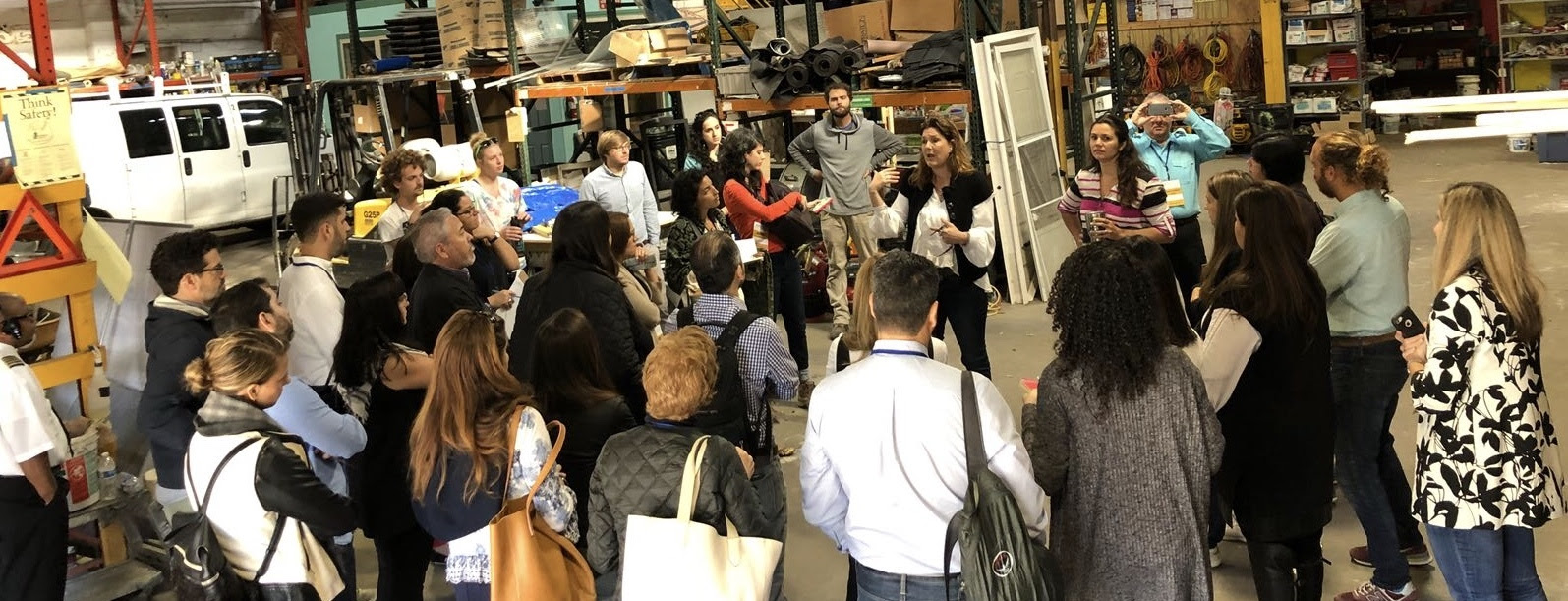 """Kristin Gisleson Palmer (center), New Orleans City Councilperson District """"C"""" and former Executive Director, Rebuilding Together New Orleans, speaks to delegation from Puerto Rico at a Preservation Resource Center warehouse."""