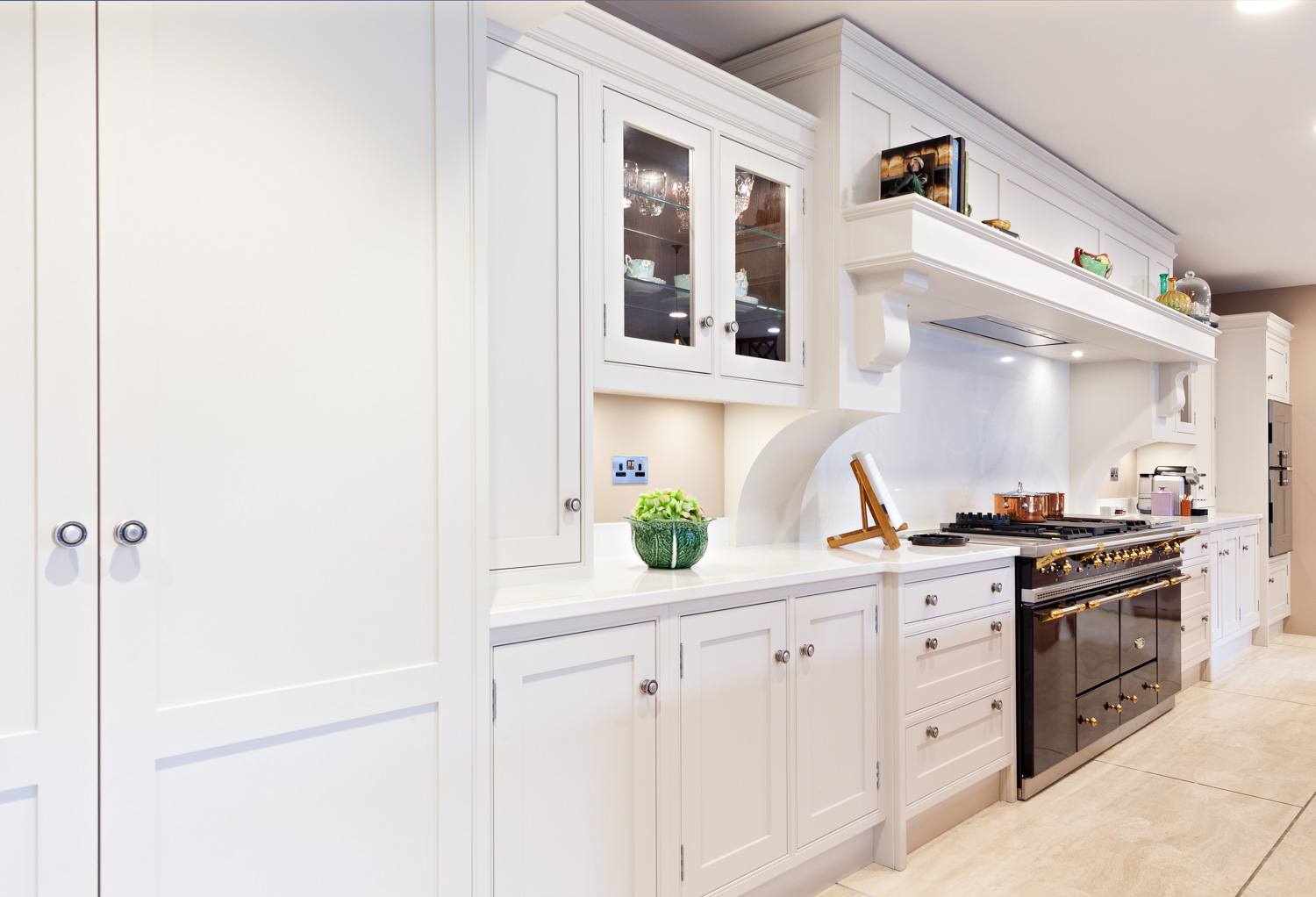 The back wall and main units of the central kitchen display at Nicholas Moody Kitchens
