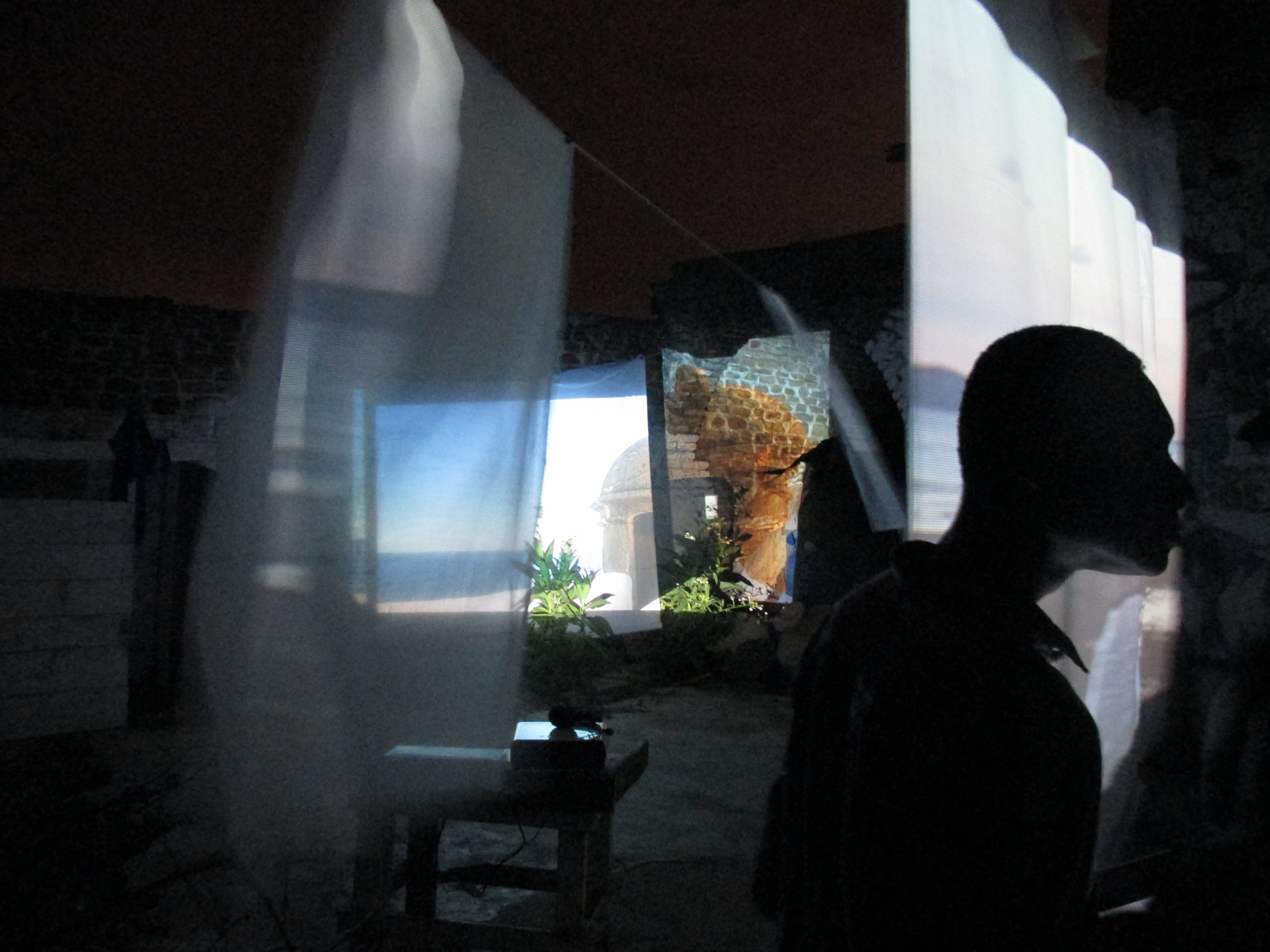 Installation View: Transatlantic Saudades screen blowing in the wind of the Atlantic with and Whitewash in the background.