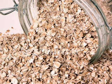 ist2_325481-container-of-spilt-raw-oats-on-table.jpg