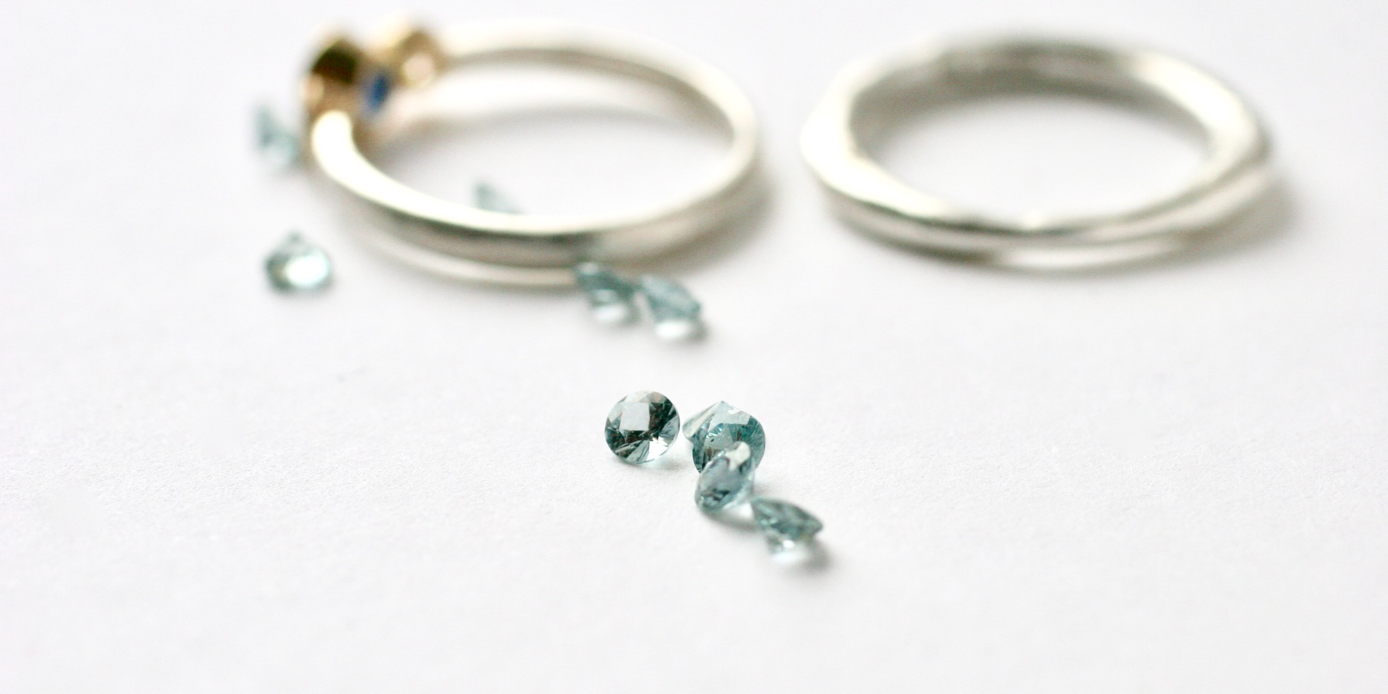 Benner-Ethical-malawi-teal-sapphires-glasswing-engagement-ring (1).jpg
