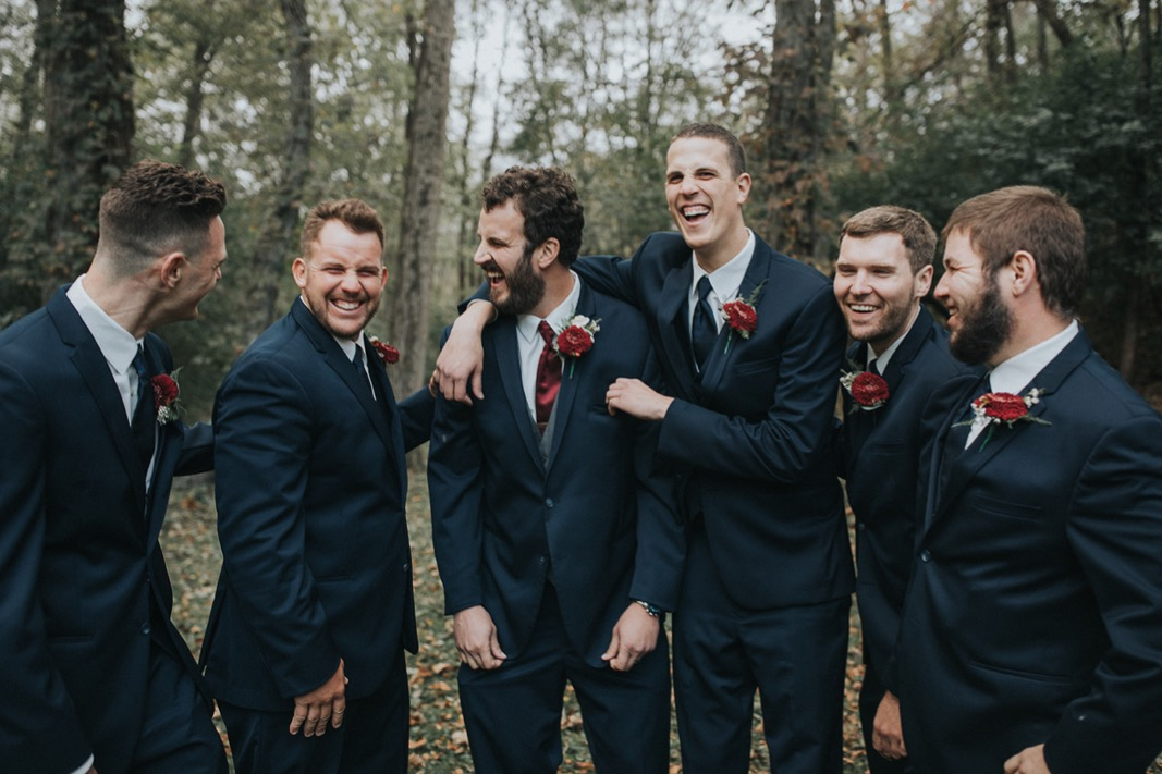 A photo of the groom and the groomsmen having fun