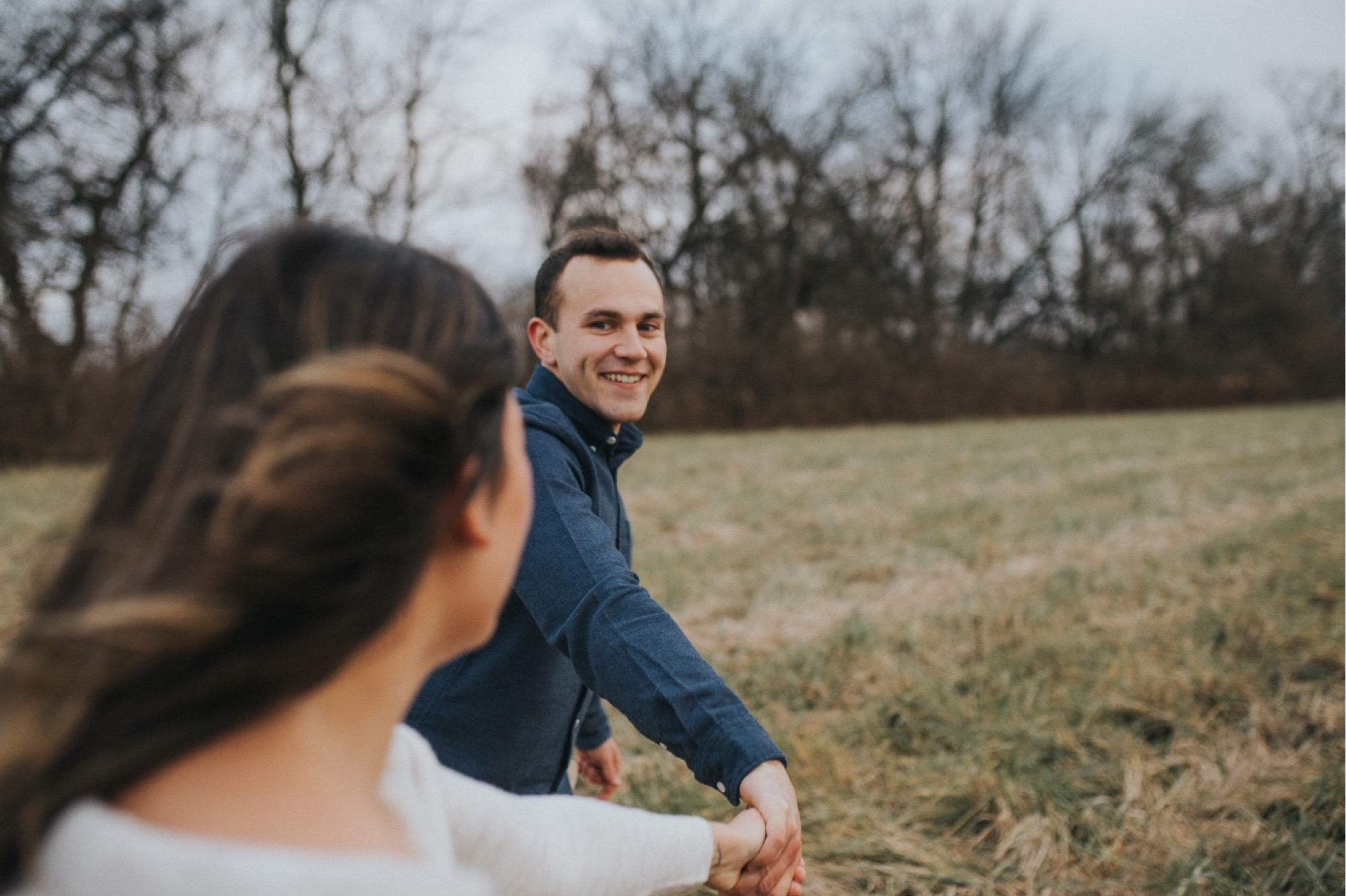 boyfriend having fun at their engagement session