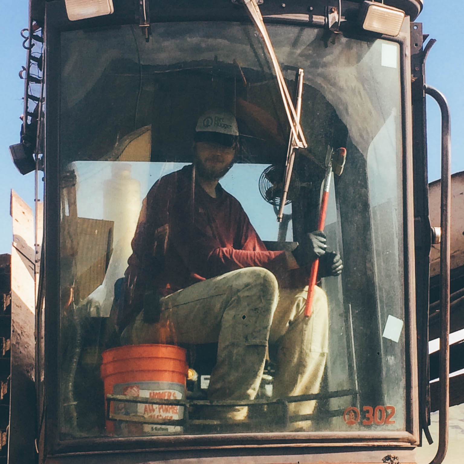 GAVIN SCHMIDT  / BLACK GOLD BANDIT  Working his way up the Dirt Hugger ranks, Gavin started out as a contamination picker and now finds himself manning the helm of a windrow turner. Additionally, Gavin is taking a lead on designing and implementing the landscape at the Dirt Hugger site. Gavin recently received a BS in Horticulture at OSU. His bag of knowledge has proven useful at Dirt Hugger where Gavin performs many of the necessary compost sample tests. Needless to say, the realm of compost is right up Gavin's alley–he spends his free time working on sustainable gardening and permaculture site design projects.