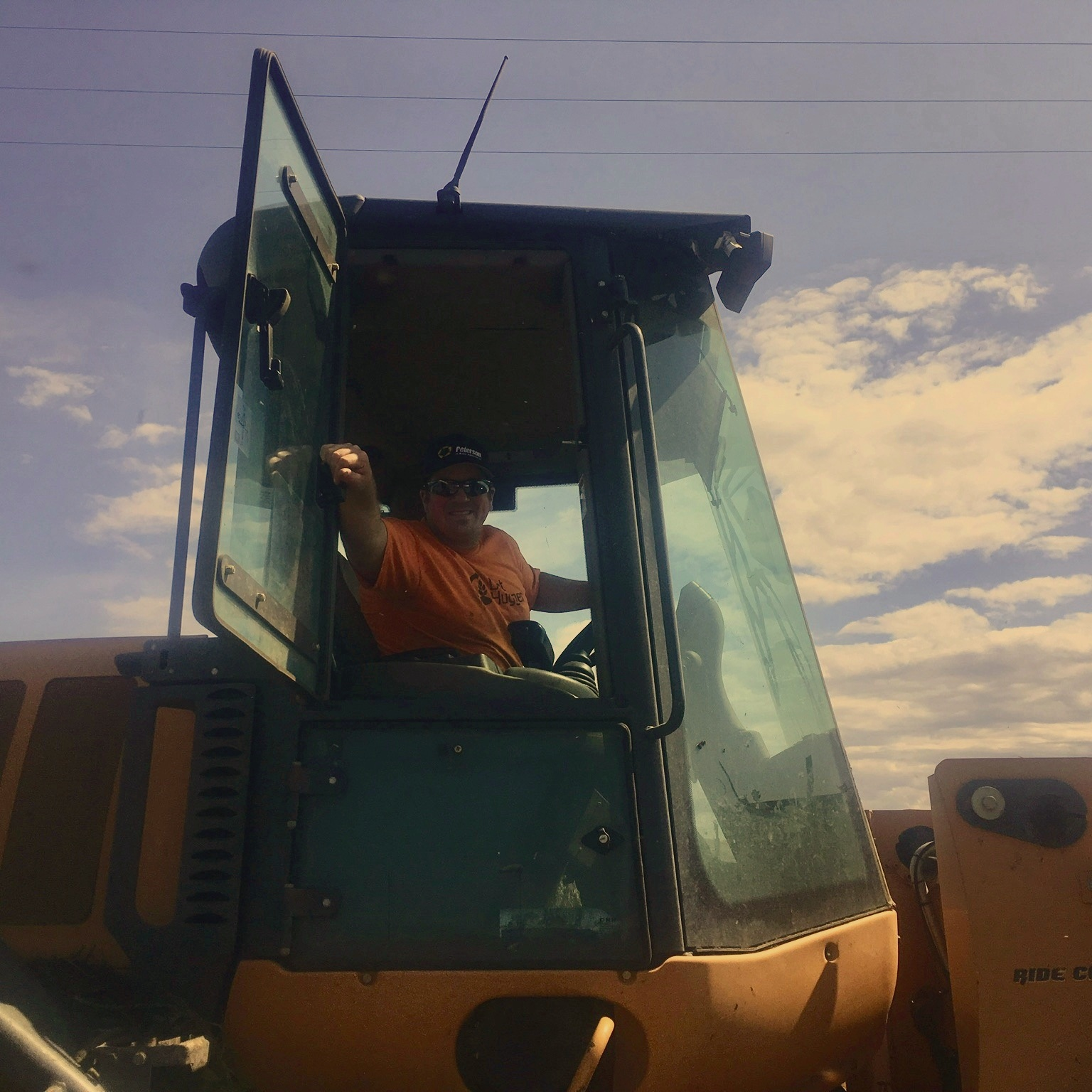 "KEVIN ""K2"" HUNTER  / POWER OPERATOR  K2 is a critical member of the Dirt Hugger team. When a brush load comes in, he shreds it. When cherry sludge is dumped, he's on it—ensuring a proper compost mix. At work and at home, he is a man with a mission. Not many people can truthfully call themselves, a powerlifter, author, motivational speaker, carpenter, punk rock drummer, and Dirt Hugger front end operator; K2 can."