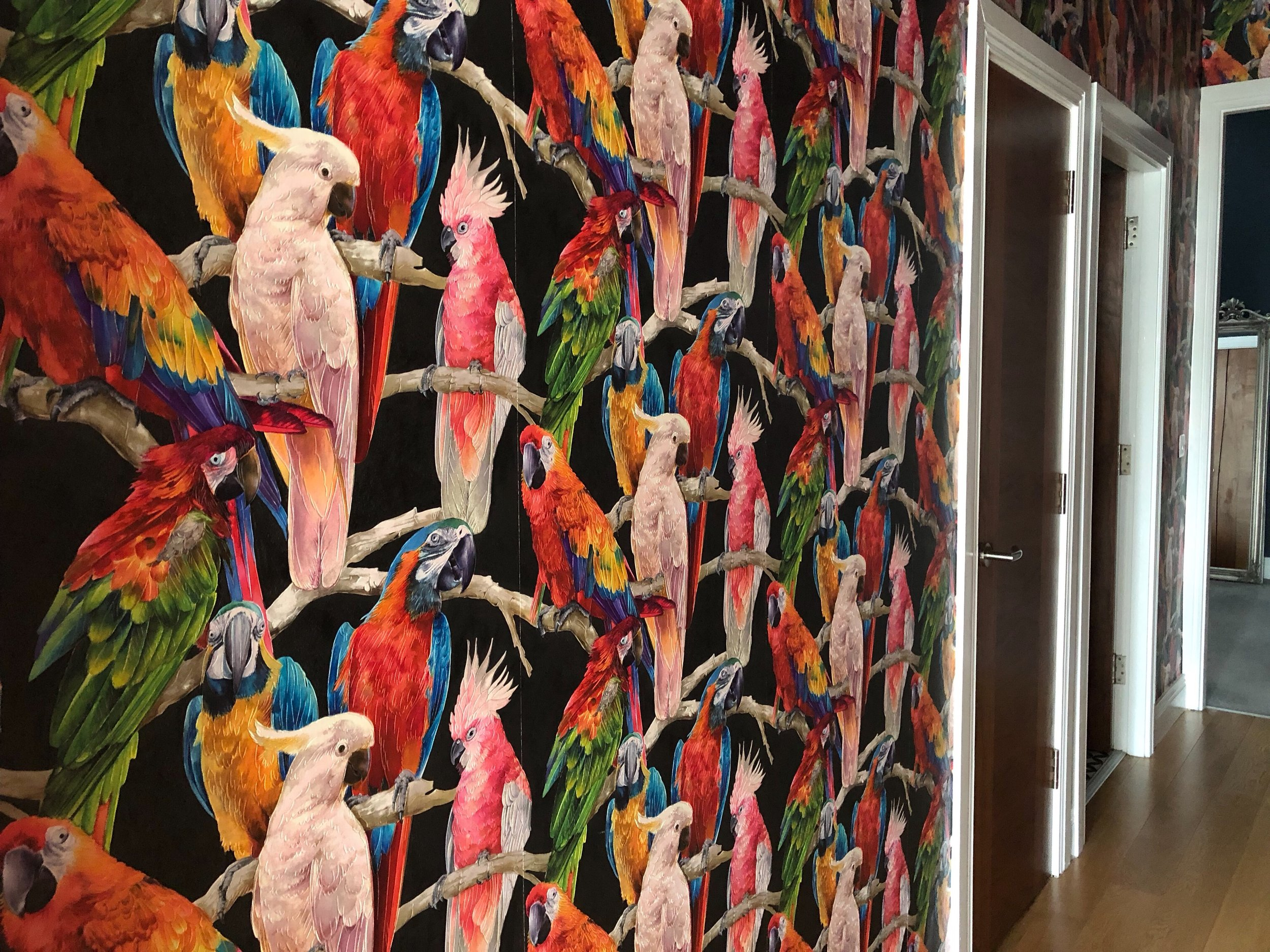 Hallway papered in Parrots wallpaper by Albany