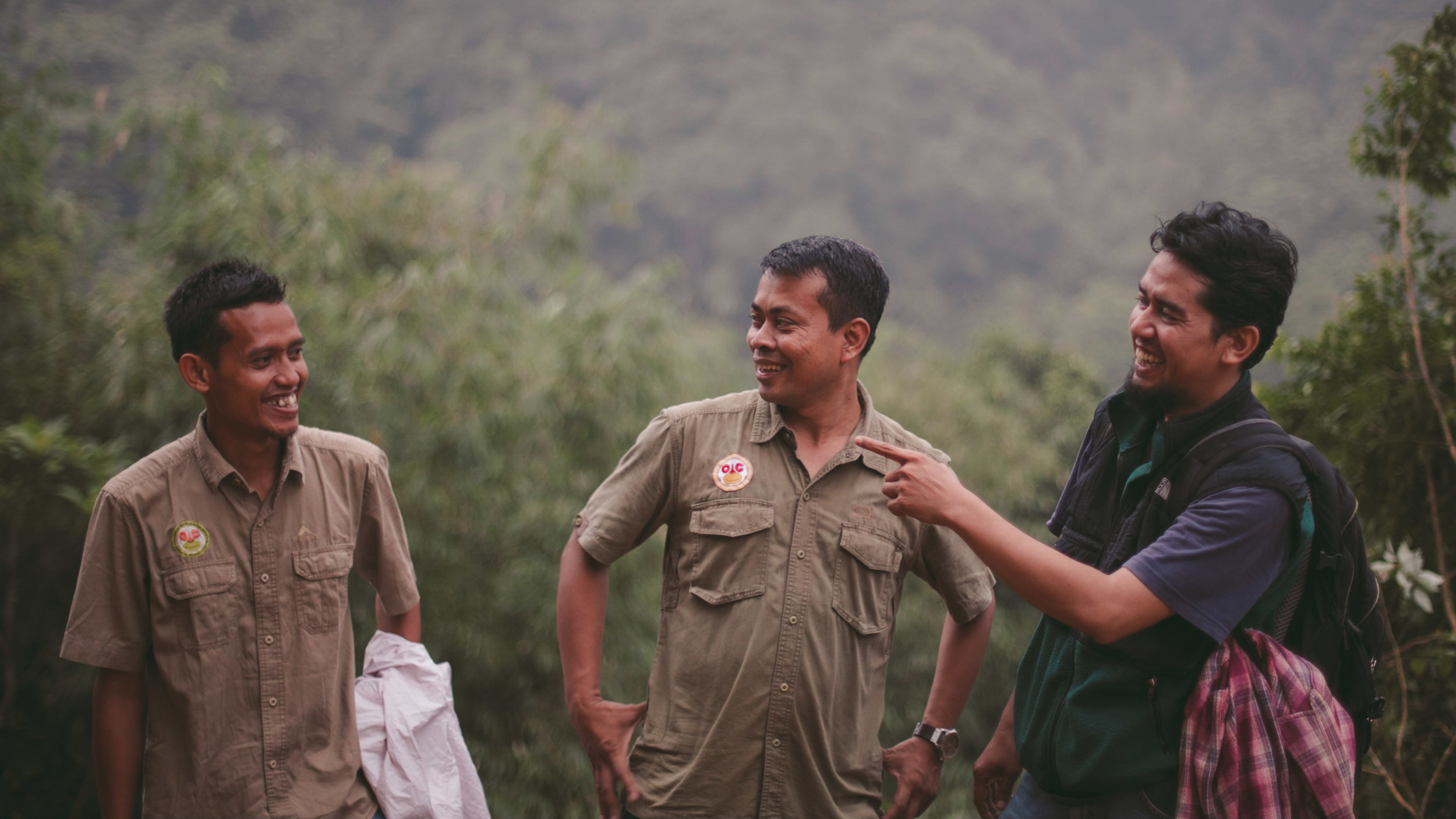 OIC staff members laughing after a hawk attacked their drone while scouting for illegal encroachment on the border of the Sumatran Wildlife Sanctuary.
