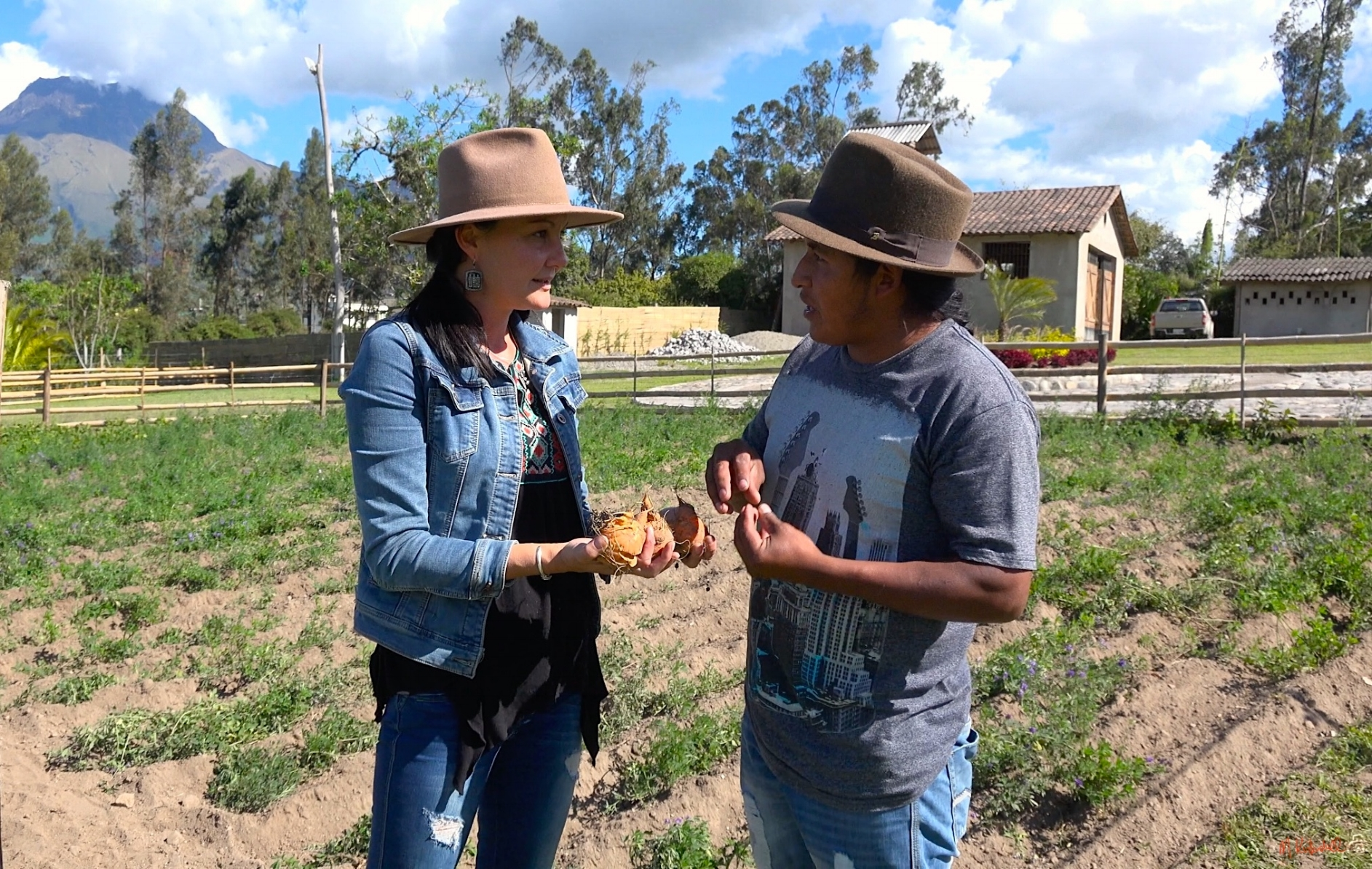 Deborah discusses with her foreman and local guide Alonzo how to deal with pests organically. Since inception of the finca, they have become dear friends.