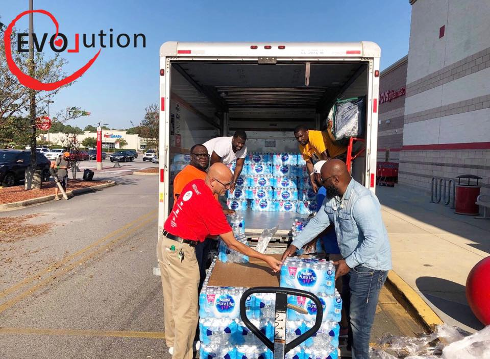 Hurricane Florence RELIEF - Hurricane Florence devastated the east coast in 2018. EVOLution partnered up with Target and the Men of Omega Psi Phi Fraternity to provide families with over 220 plus cases of bottled water and other supplies.