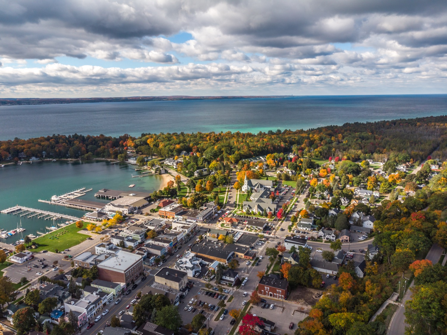 The Festival would like to thank Nate Graham and Paul Heneks of InPlaneView for the use of this photograph. All  InPlaneView  books benefit the Harbor Springs Community Food Pantry. This aerial view of Harbor Springs will appear on the 2019 Festival program cover and commemorative poster.