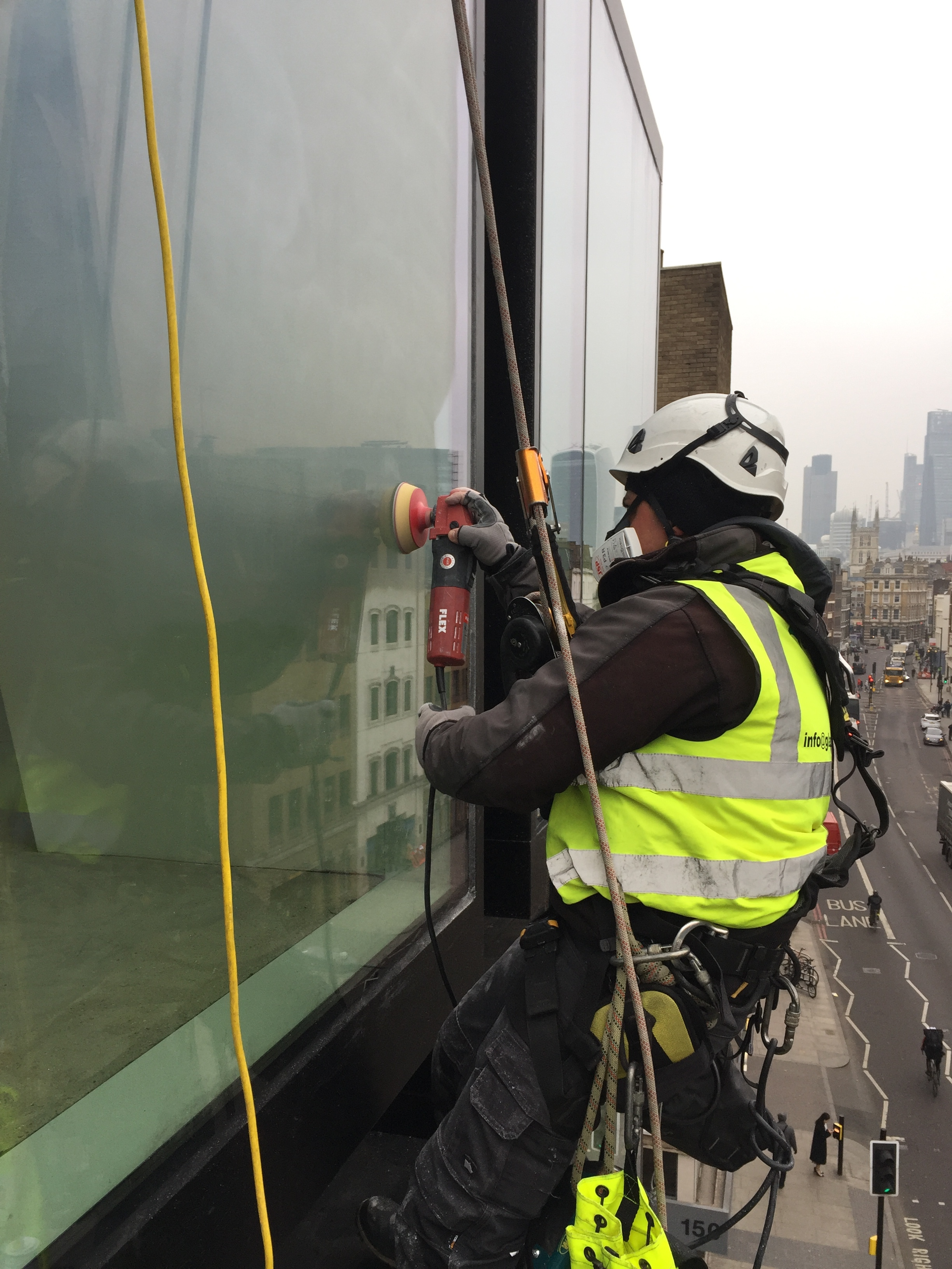 Polishing of entire structurally bonded glass via abseil.