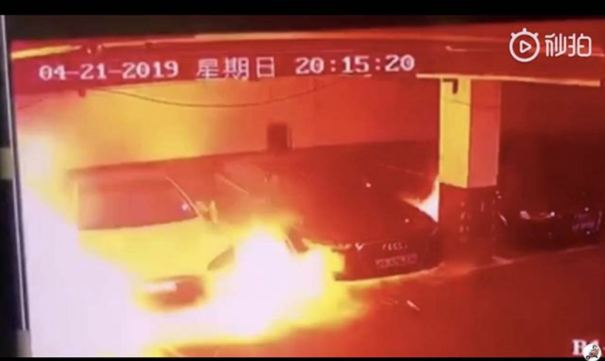 Photo: A Tesla Model S at a parking lot in Shanghai erupted in to flames in late April. Tesla has since updated software to prevent future incidents.