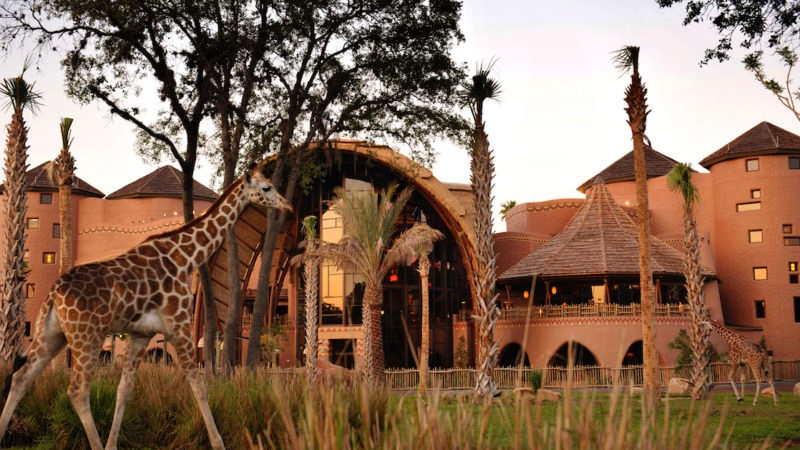 Exotic animals roam free oveR picturesque tropical grassland at this African lodge-style Resort. -