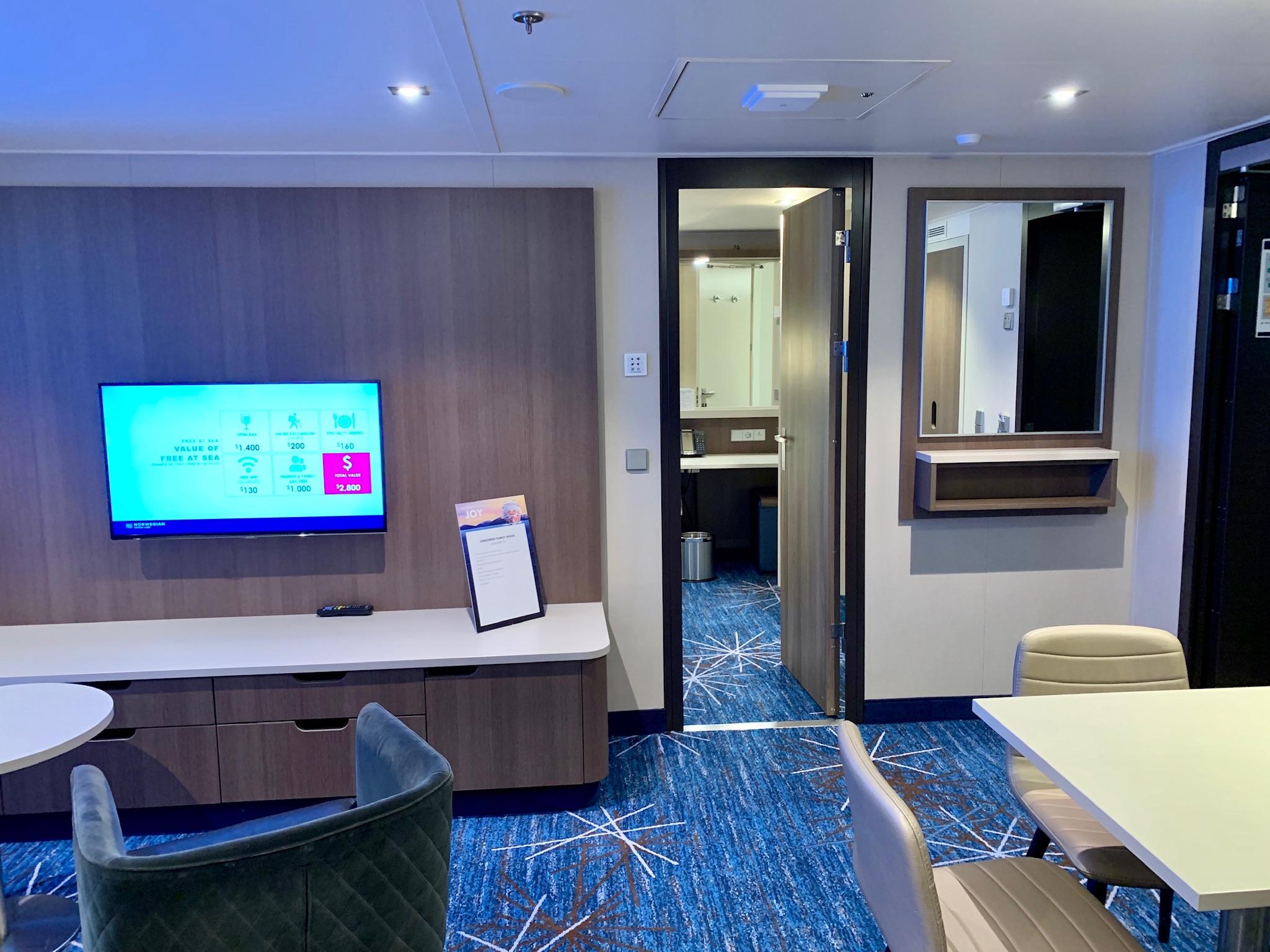 NCL Joy Concierge Family Suite media wall