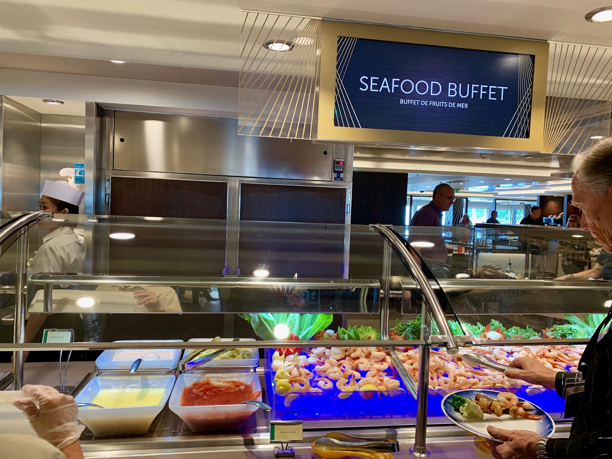 NCL Joy - Dining - Garden Cafe Seafood Bar with Sign.jpg