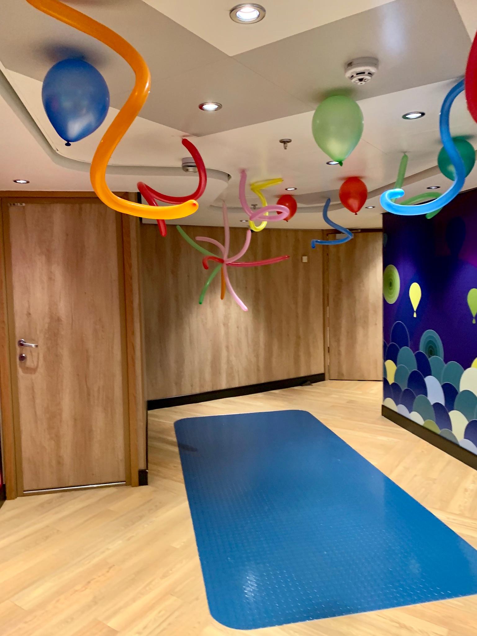NCL Joy - Amenities - Splash Club entrance hallway.jpg
