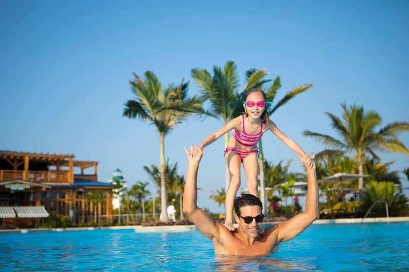 Dad and daughter enjoying pool time on Harvest Cay Belize (c) NCL