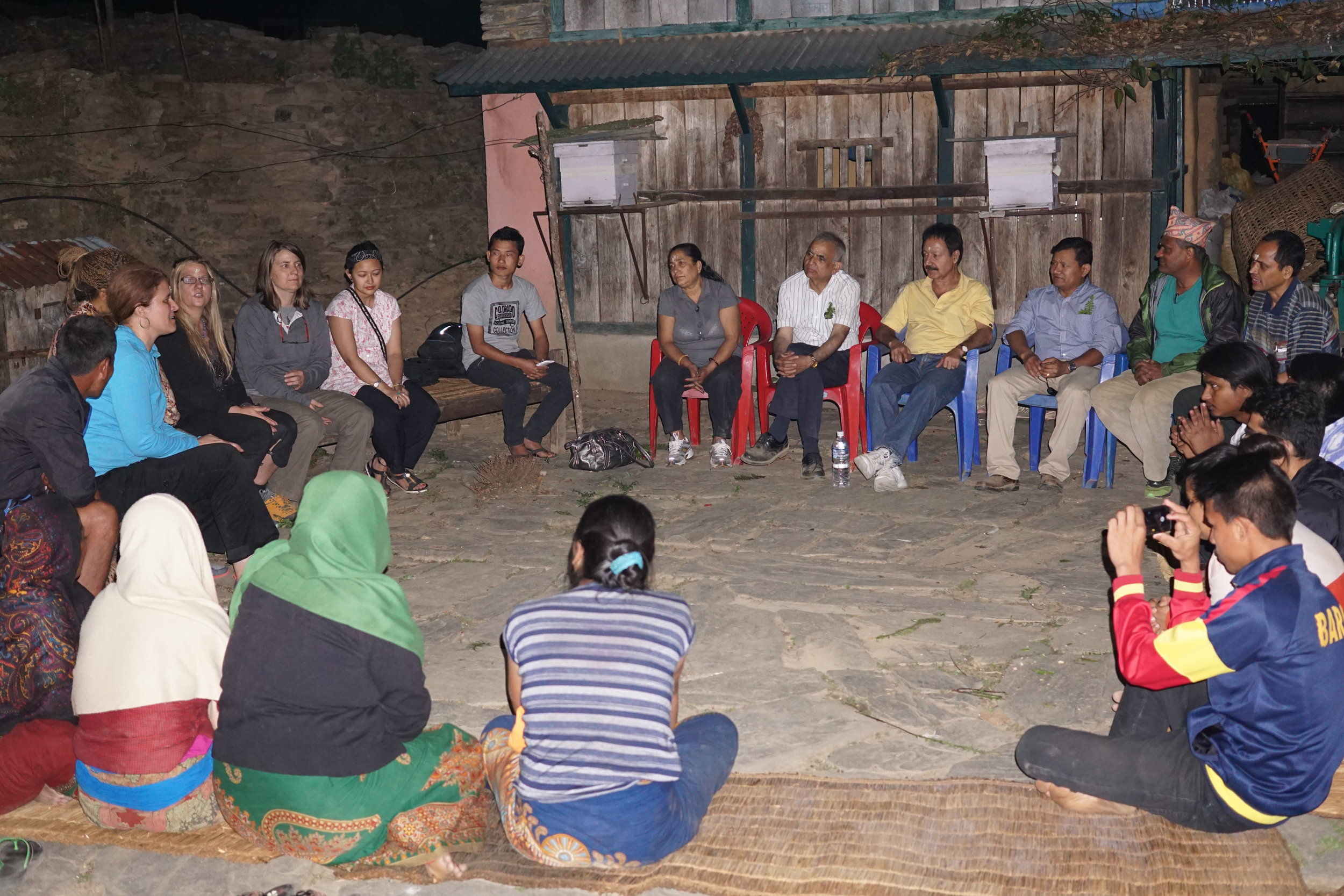 Facilitating a discussion of the rebuilding plans with the villagers in Rainaskot and volunteers from the US and Canada in 2016