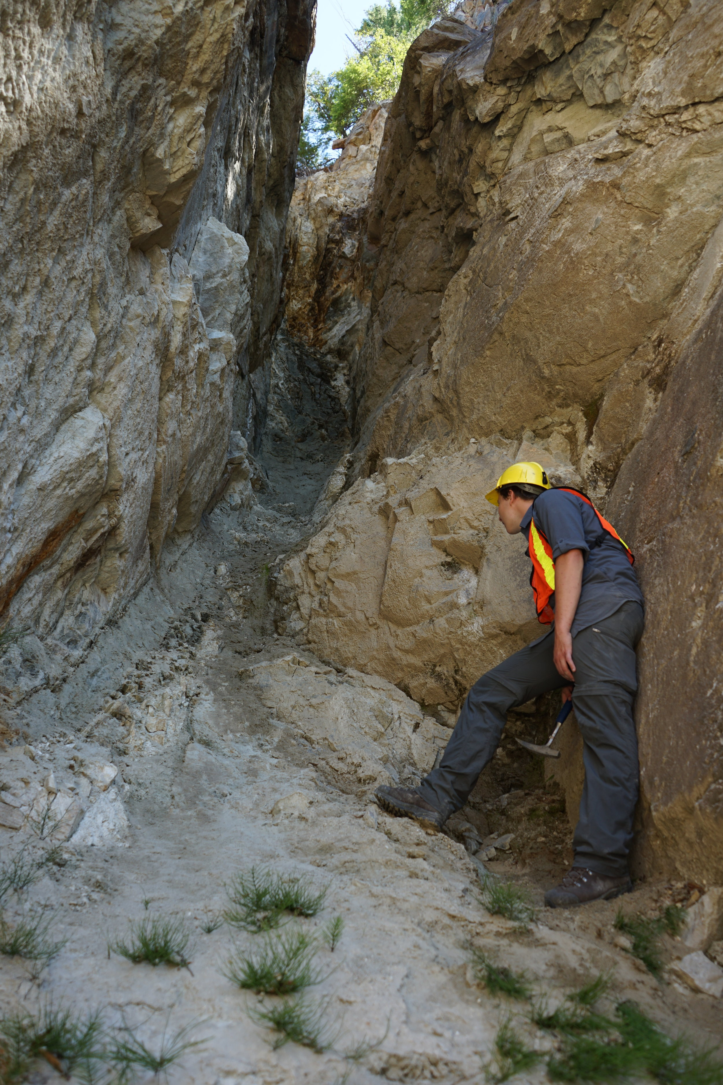 Inside a large strike-slip fault with a wide gouge zone. Slickenlines are also faintly visible on the right hand side, above Noah's head.