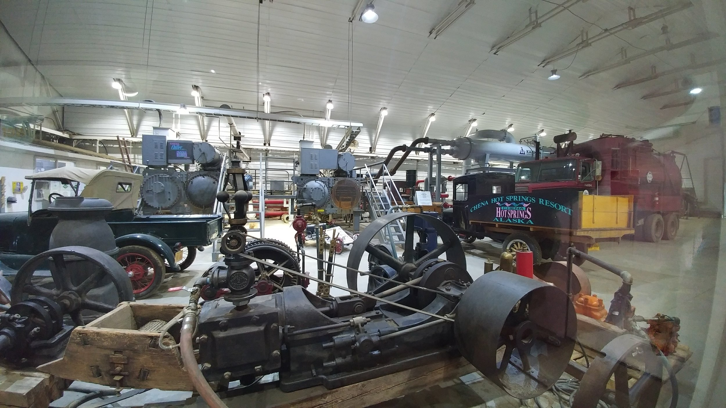 The power plant at Chena Hot Springs along with an assortment of older machinery. Three Organic Rankine Cycle (ORC) engines are installed, producing approx. 400kWh.