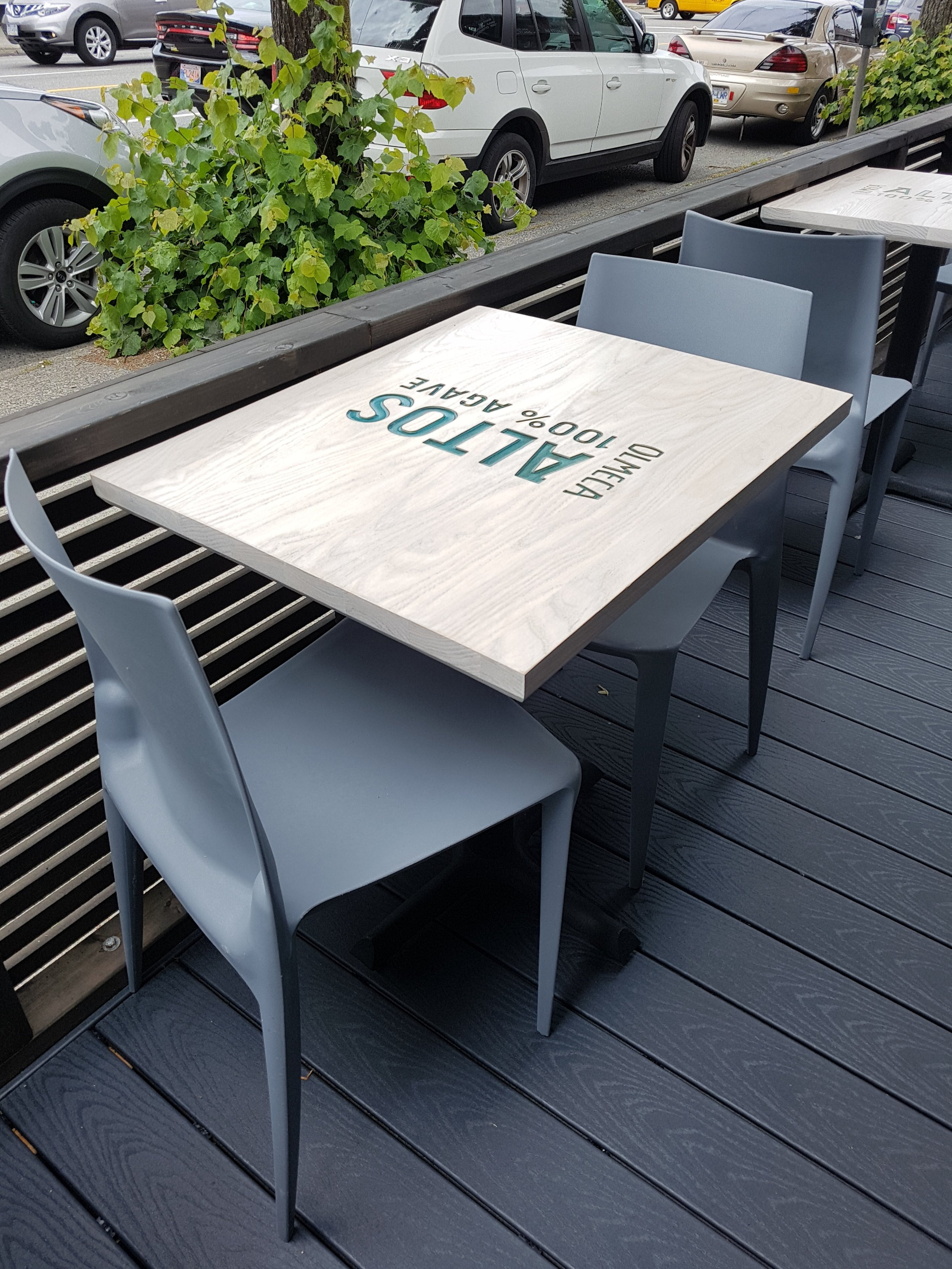 Restaurant Table in White Washed Ash. Turquoise Blue Epoxy Branding Fill.  El Caminos, Main St. Vancouver, B.C