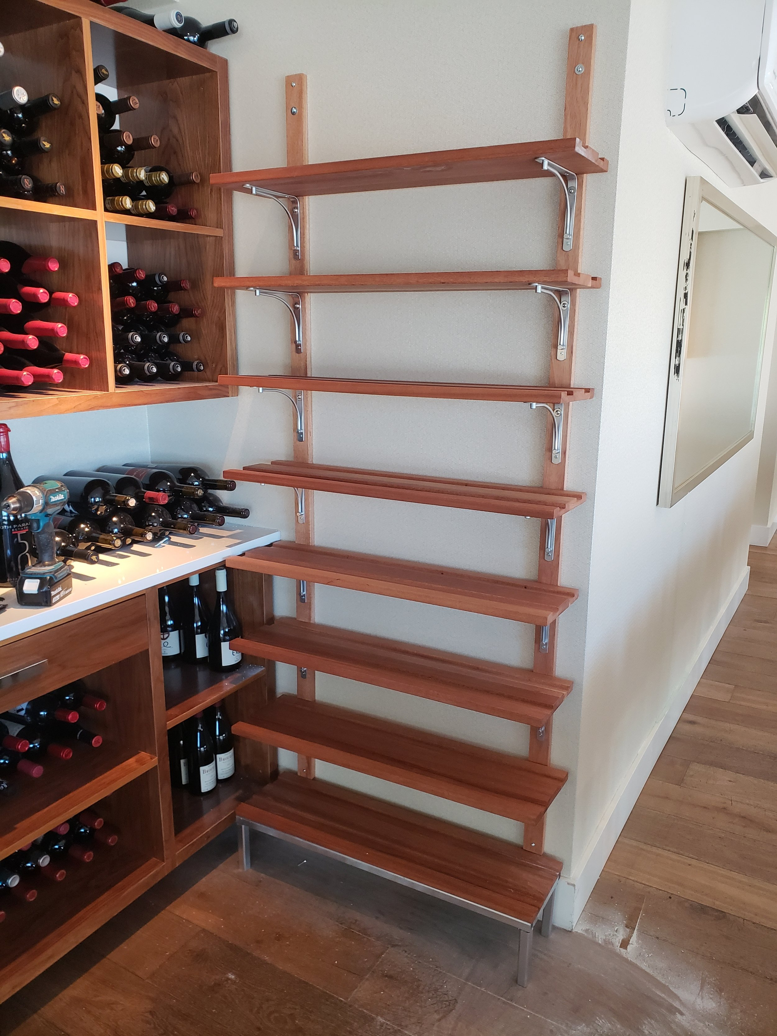 African Mahogany Wine Rack. With Chrome Accents.  Ancora Fine Dining, Howe St., Vancouver,B.C