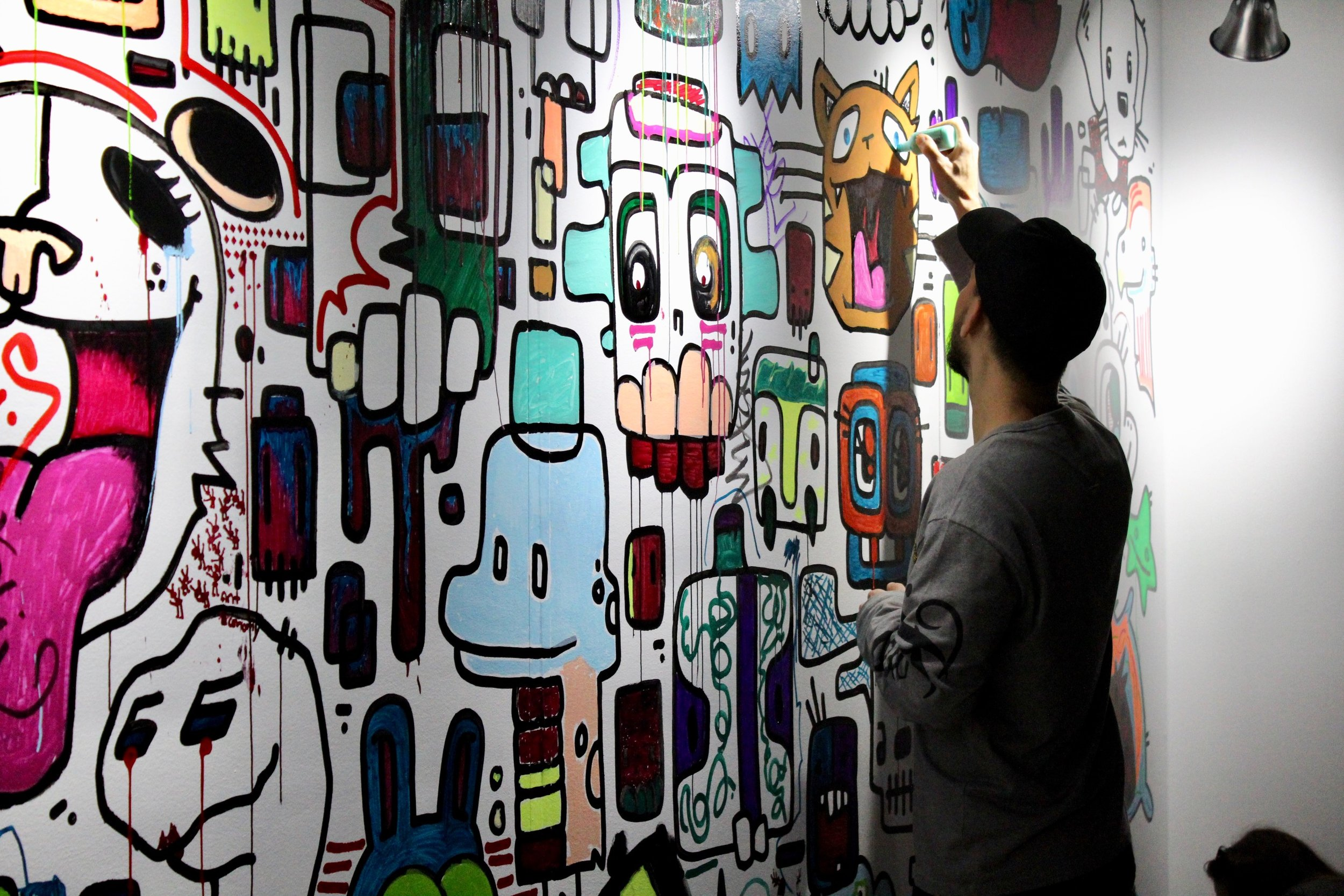 Artist Mike Shinoda of Linkin Park adding to the wall