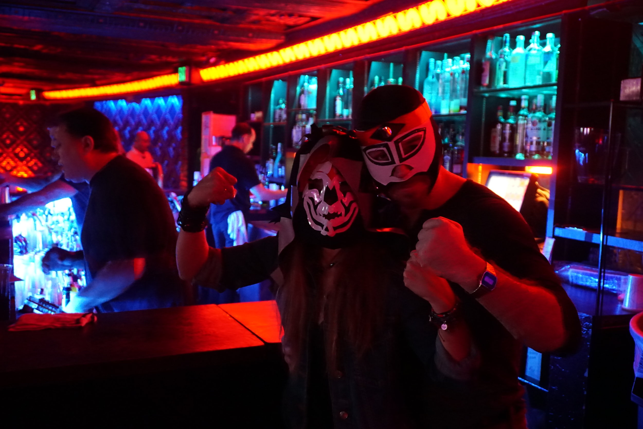 masked fans at the bar by Andrea Antolini