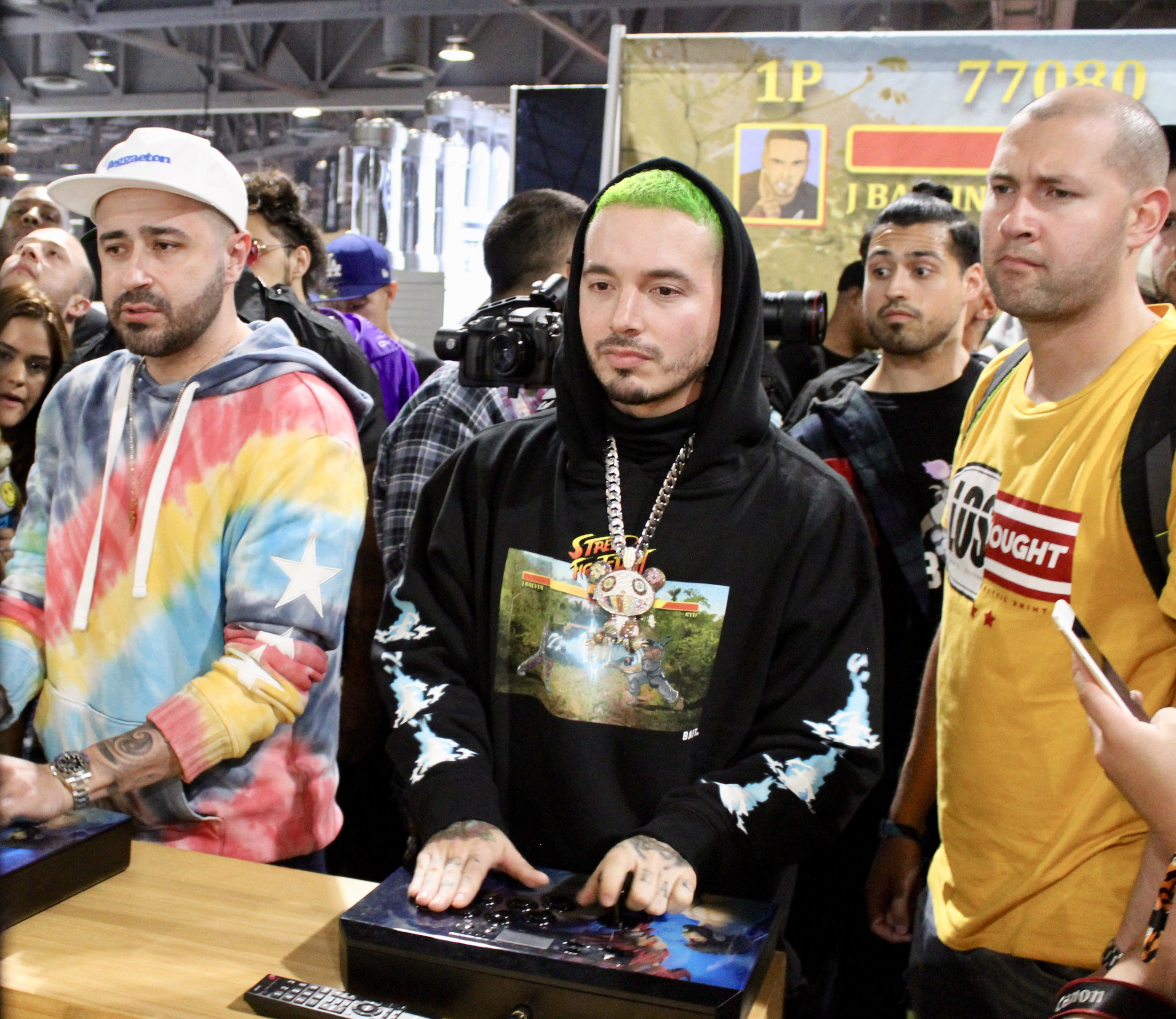 J Balvin playing Street Fighter at BAIT booth