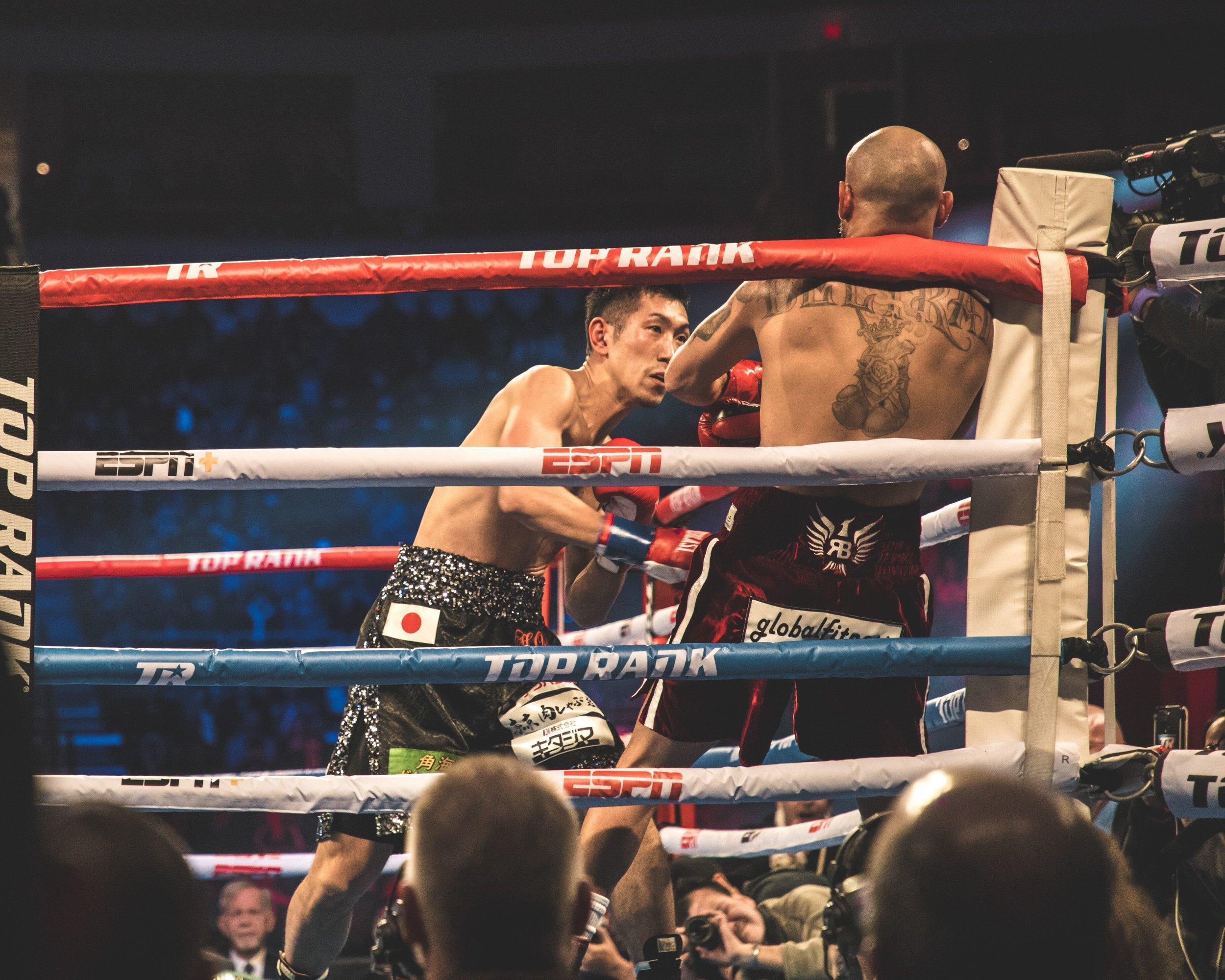 Hiroki Okada pins Ray Beltran against the ropes by Benny Blanco