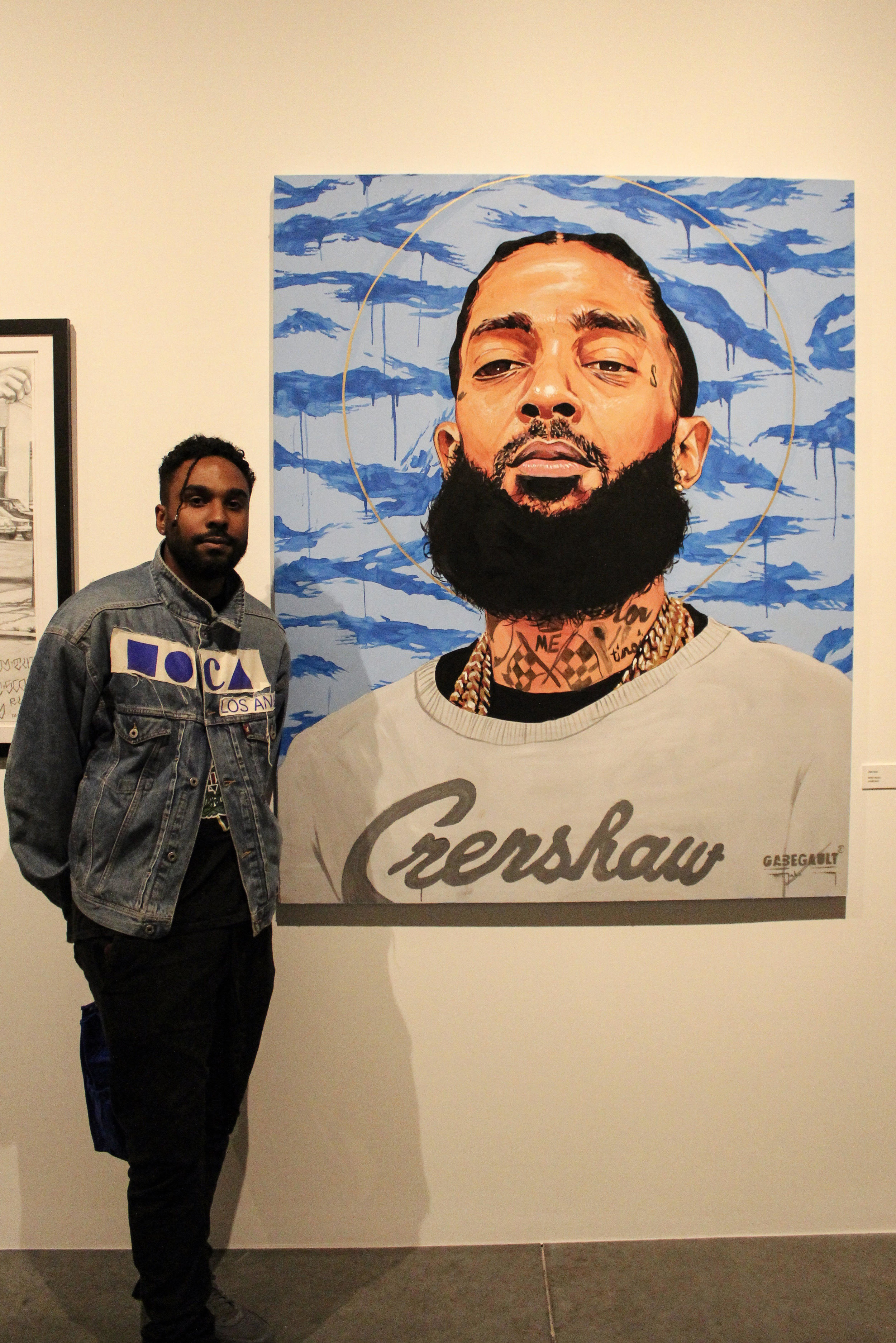 Gabe Gault with his portrait of Nipsey Hussle by Roger Martinez