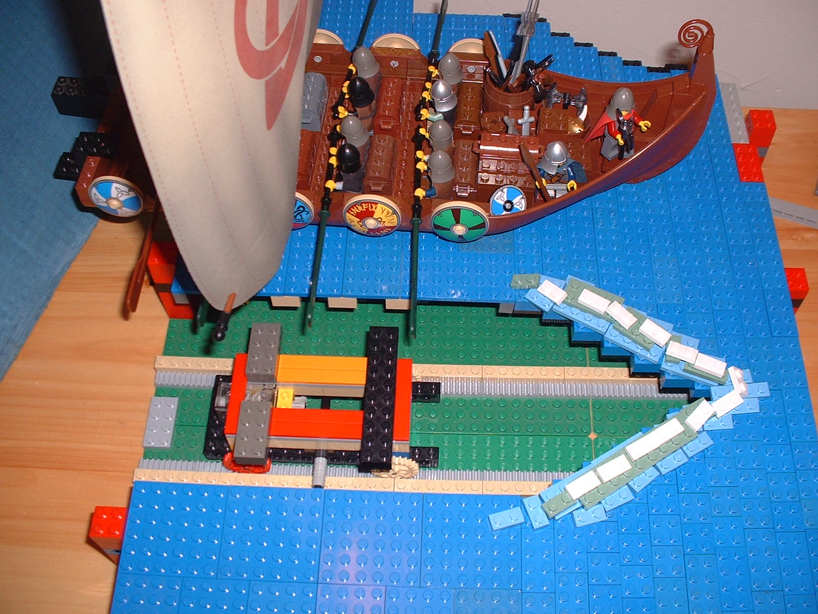 The viking ship was missing its back half and was attached to a rail. Water was a combination of sliding pieces and loose pieces on top