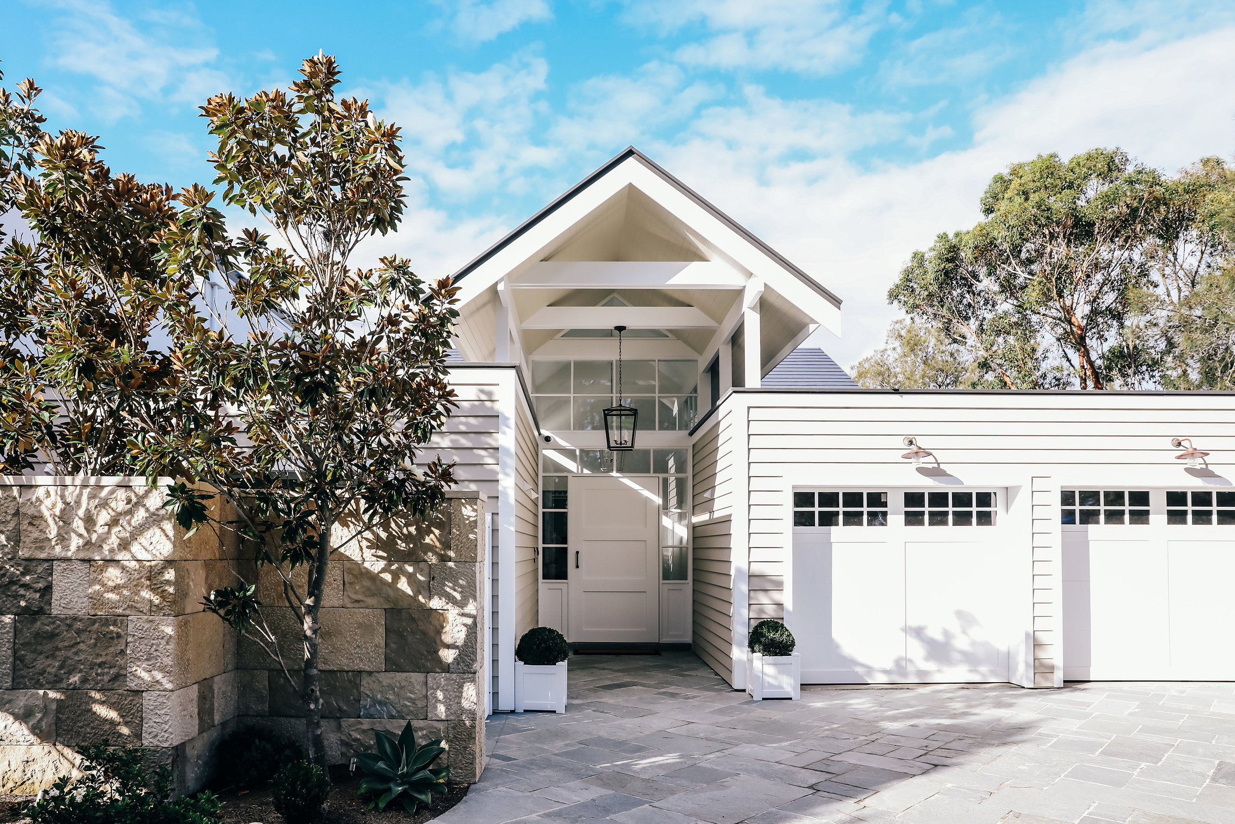 Hamptons entry doors and garage doors