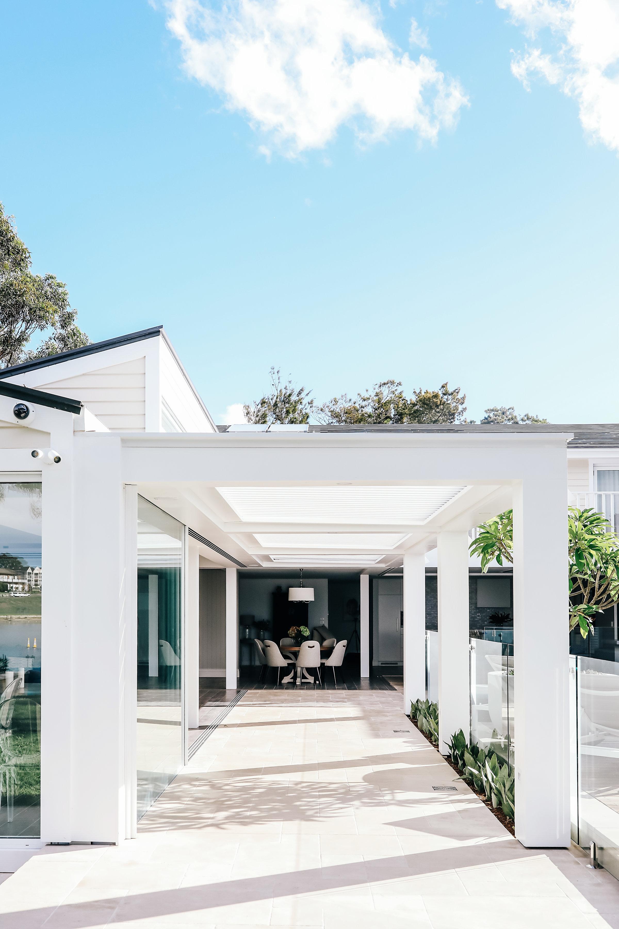 Bespoke designed awning, limestone tiling and pool area.