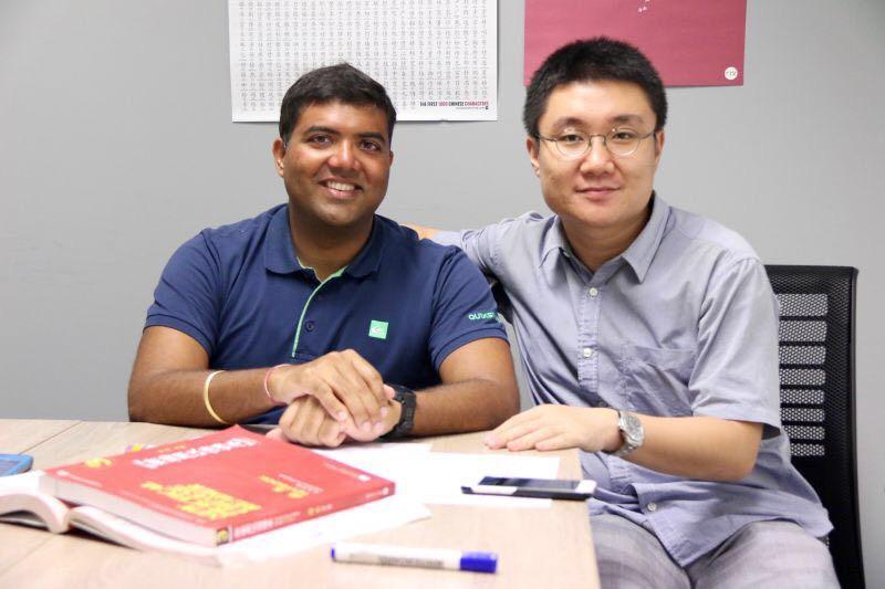 Chinese Teacher Timothy Wang and student Tushar.jpg