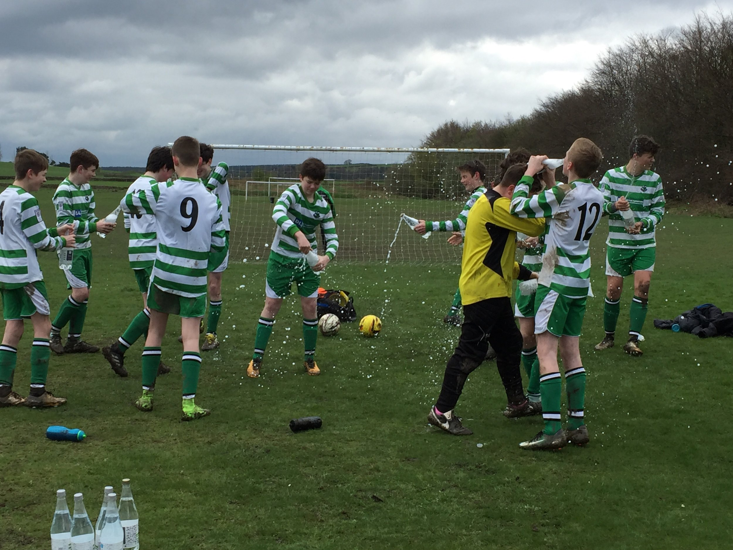Hallam Rangers U14s celebrate the moment.