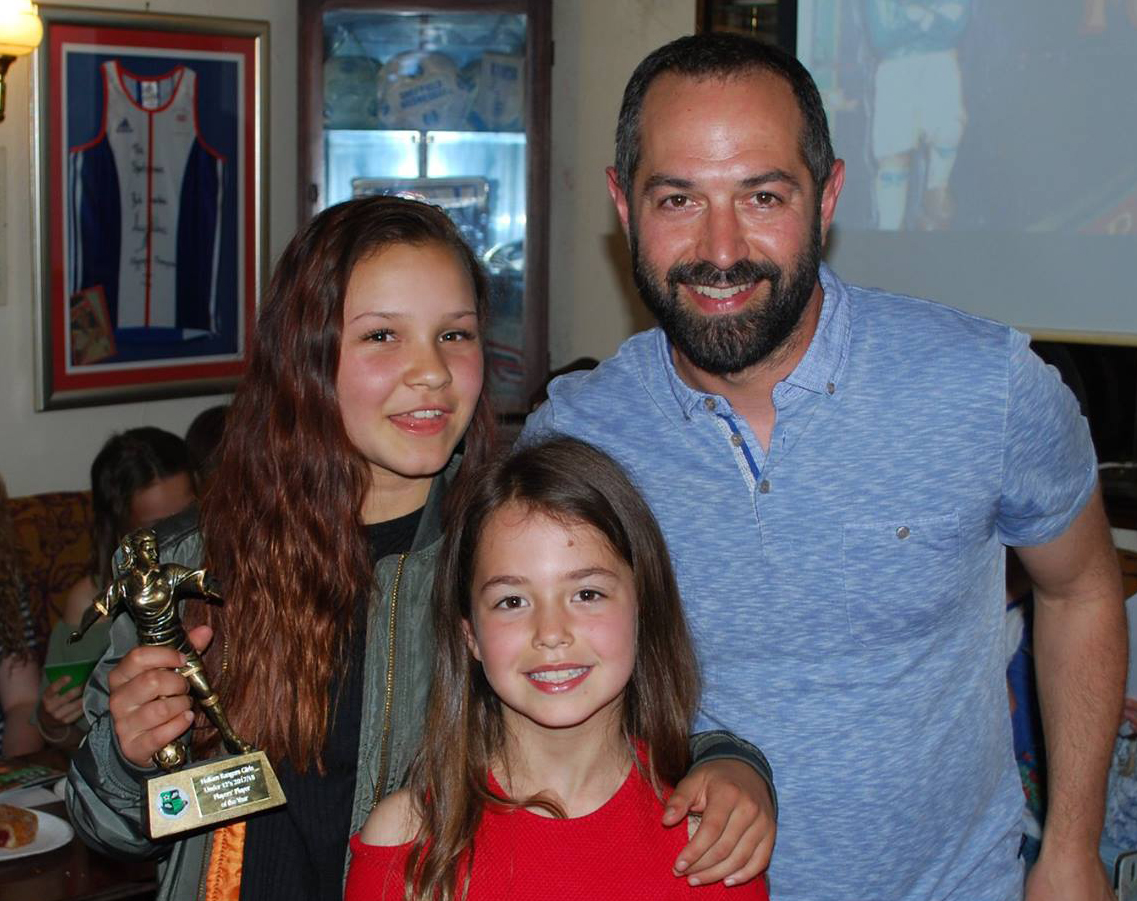 Kira receives the Player's Player Award from Manager Dan Gordon