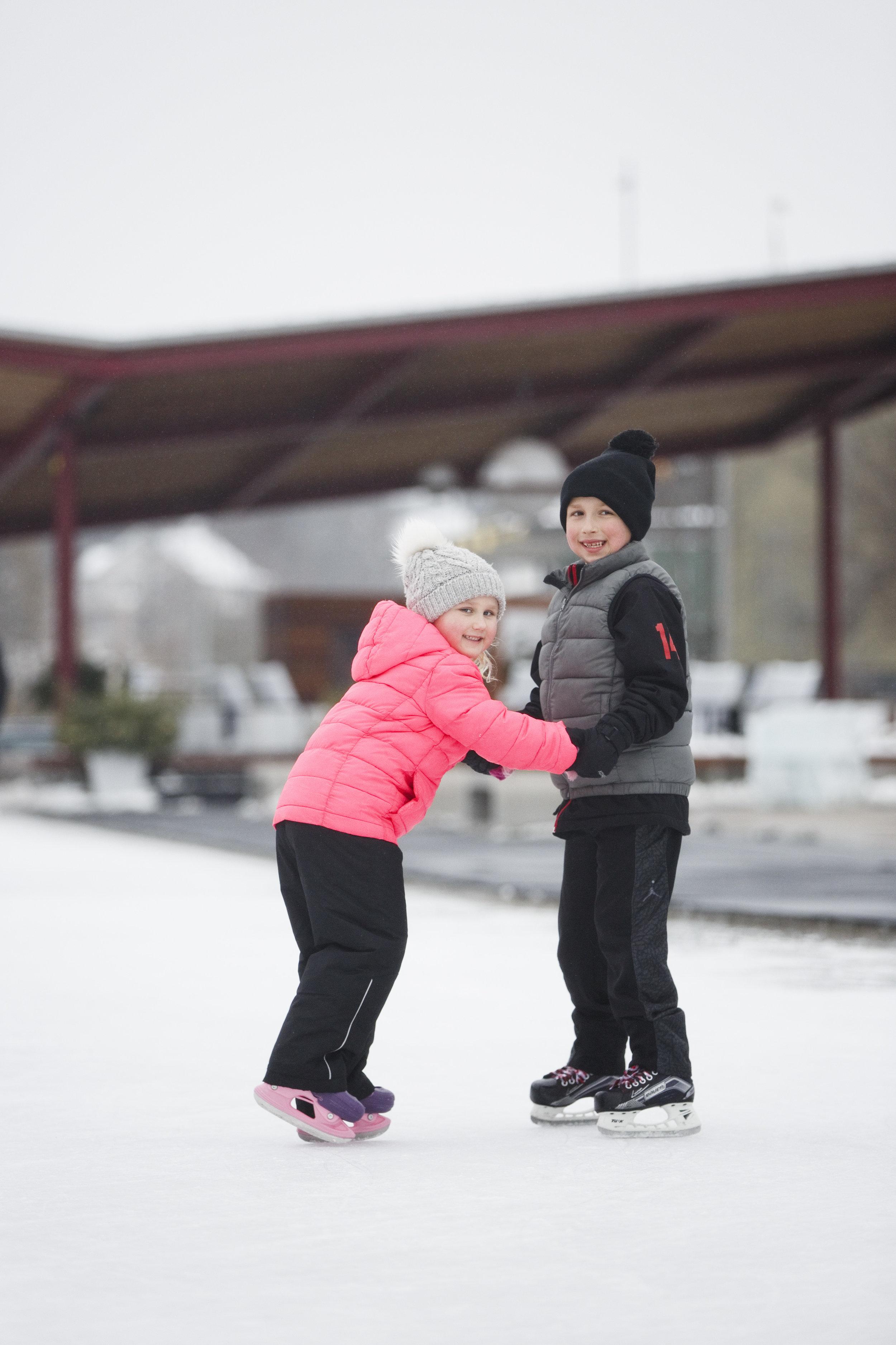 Boy and Girl Skating at Riverwalk Commons