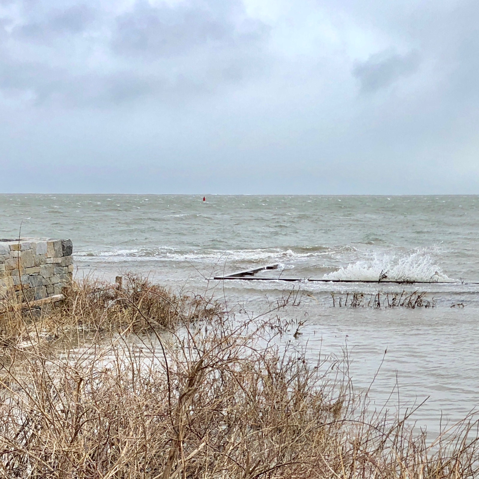 Our neighbor's beach in front at 42 Winsor Street. Tides are still running high, as is the wind.