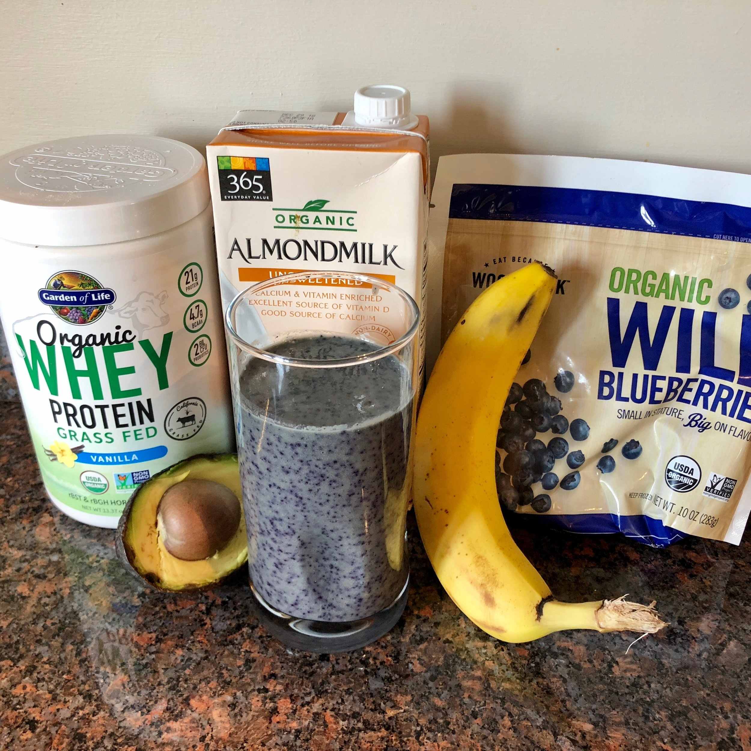 Almond milk, whey protein, avocado, banana, pomegranate (not in the picture) and blueberries.