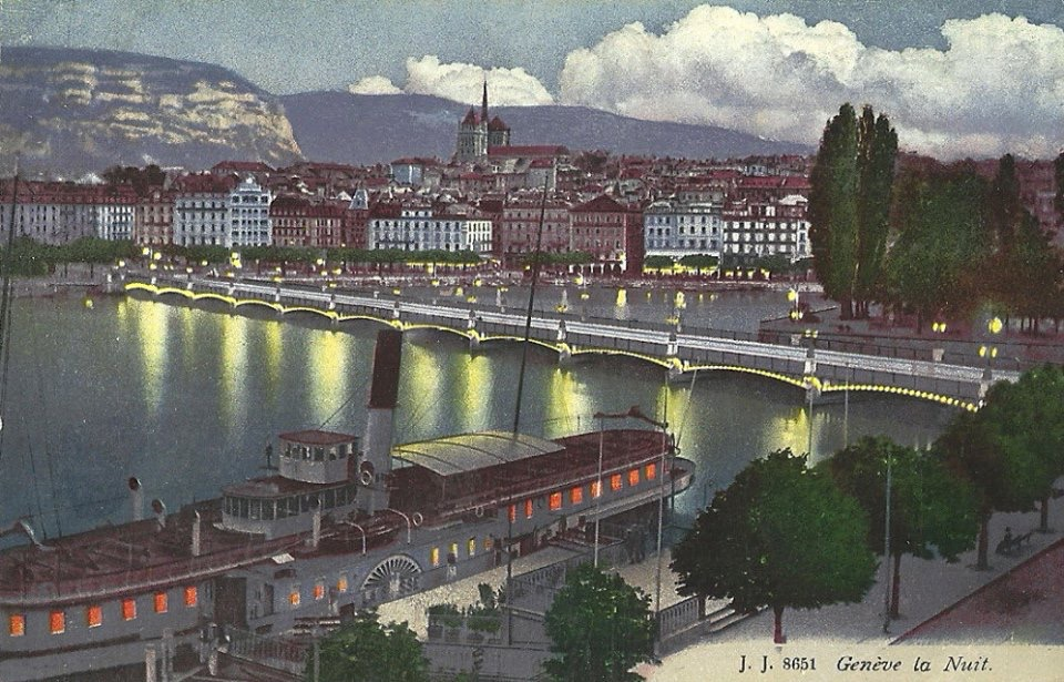 Vintage Postcard of Geneva with a view of the Mont Blanc Bridge, Lac Léman, a paddle boat, the Old Town and the Salève in the background by night.