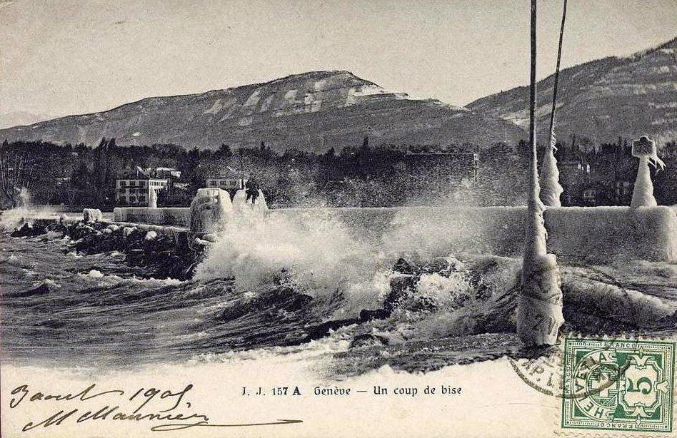 Vintage postcard of Geneva, Un coup de Bise, with an icy view of Lac Léman and the Salève.