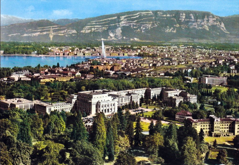Vintage postcard of Geneva with an aerial view over the UN buildings, Lac Léman, the Jet d'Eau and the Salève.