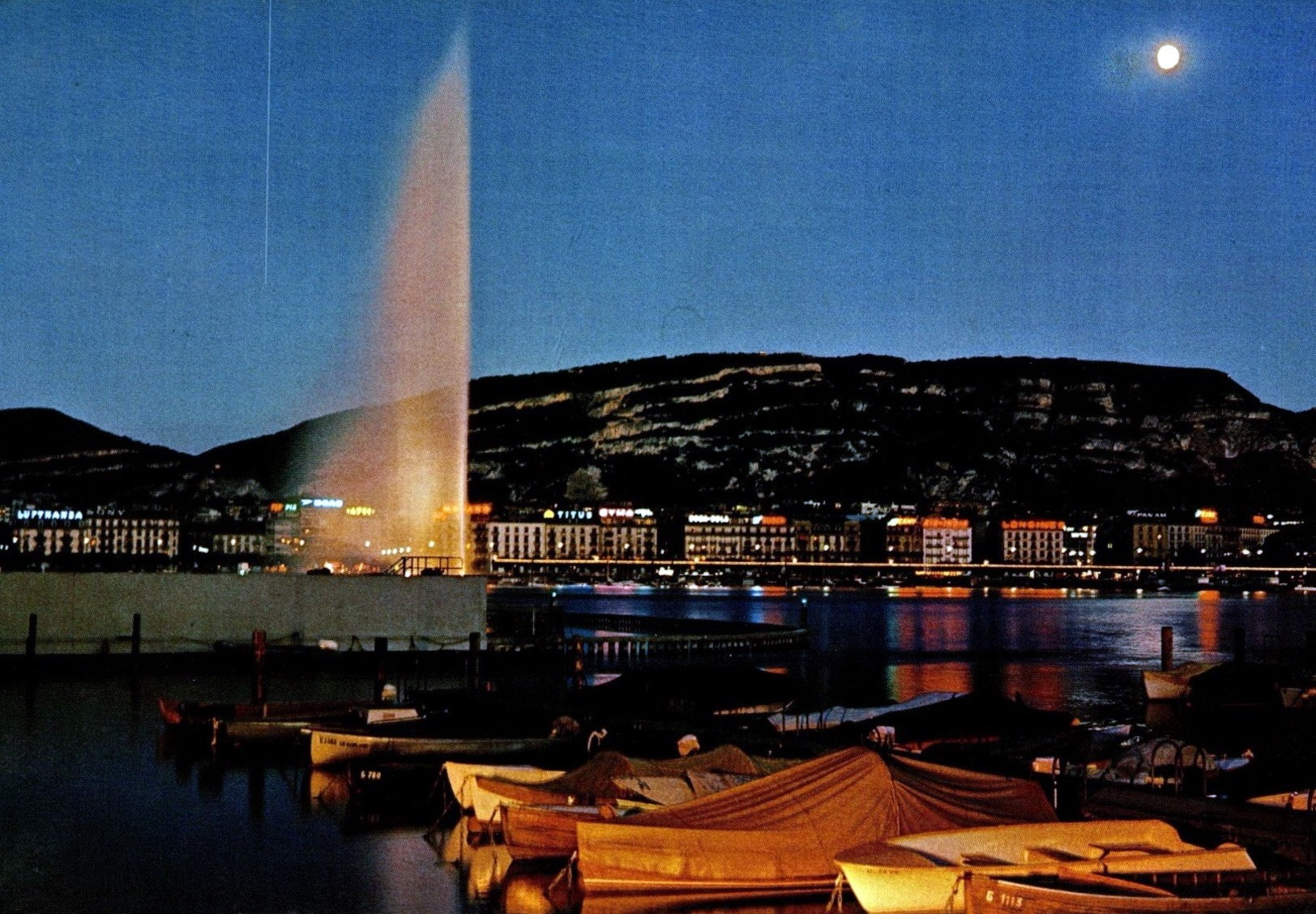 Vintage postcard of Geneva with a view of the Jet d'Eau and the Salève by moonlight.