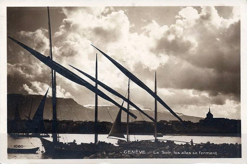 Vintage postcard of Geneva with a view over Lac Léman and traditional sailboats and the Salève in the background.