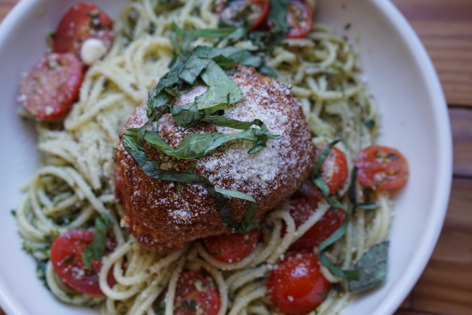 burrata parmesan - fried burrata, spaghetti, sweet basil pesto, grape tomato, parmesan cheese, basil