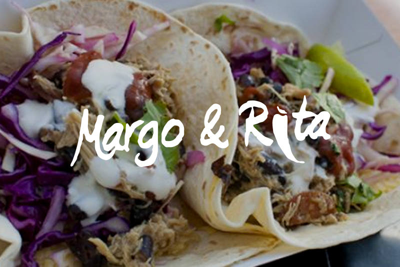 Margo & Rita - Making their way to us from south west London's leafy Surbiton, are the marvellous Mexican food maestros Margo & Rita.Using only the very best — and locally sourced — ingredients, they'll be serving up the greatest burritos & tacos this side of the Atlantic.