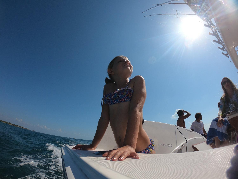Isla Mujeres Girl Enjoying Sun on Boat