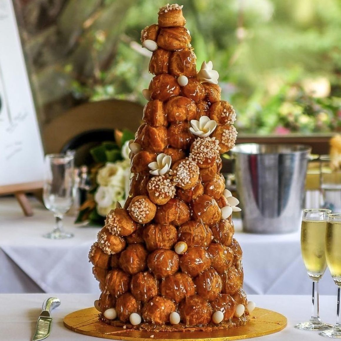 This mile-high pastry display is the perfect level of extravagance for your French-inspired wedding desserts. Photo from:  Croquembouche Patisserie